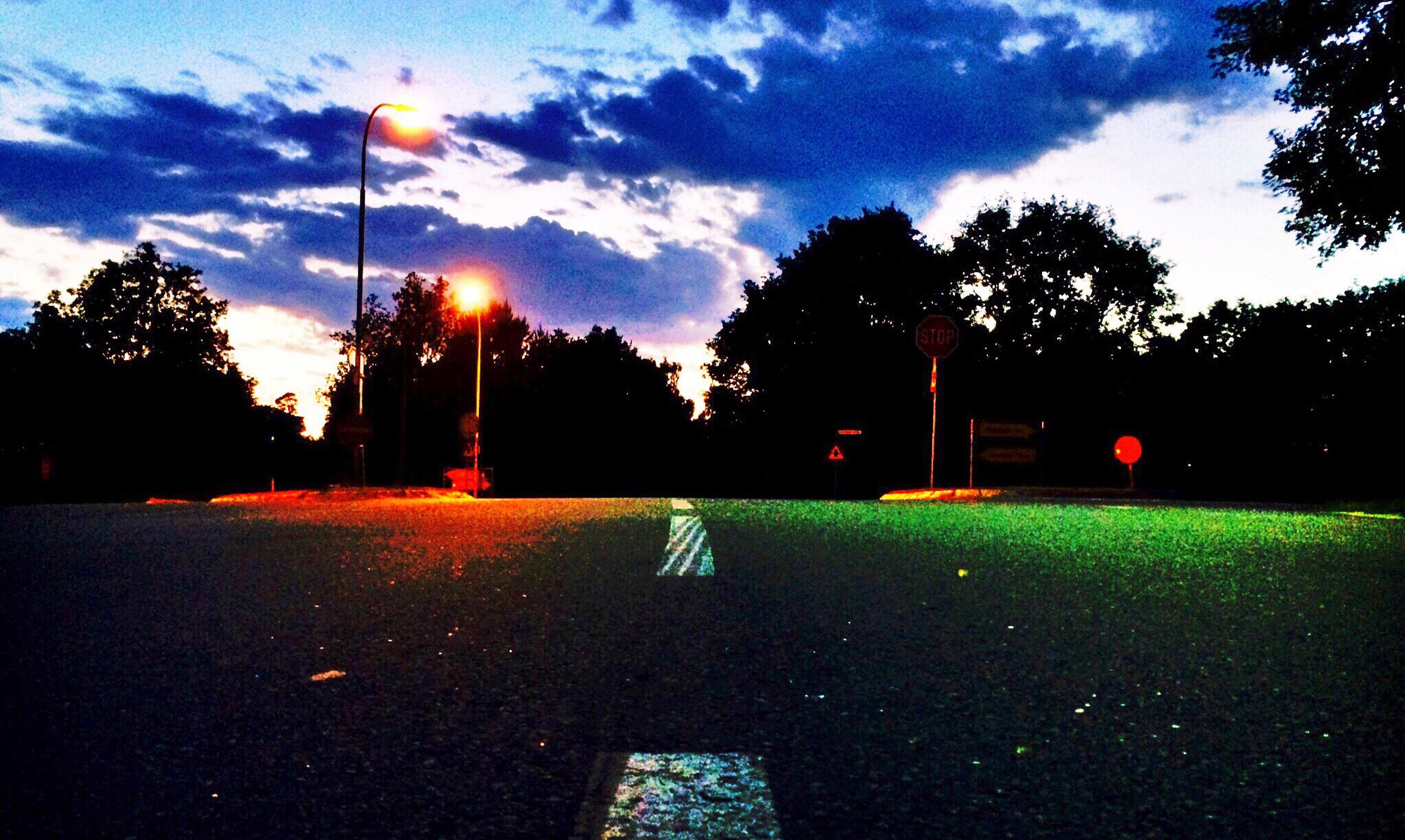 tree, sky, street light, silhouette, sunset, transportation, road, cloud - sky, street, dusk, cloud, lighting equipment, tranquility, empty, nature, illuminated, sunlight, the way forward, outdoors, car