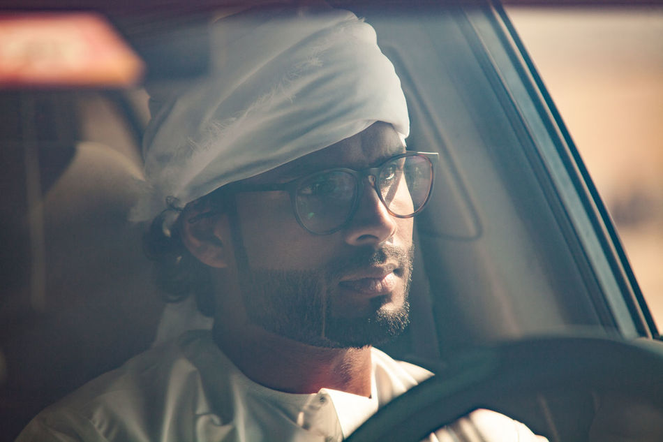 Adult Adults Only Arab Man Beard Close-up Day Driving Emirati Emirati Arabi Eyeglasses  Human Body Part Indoors  One Man Only One Person Only Men People Stubble Sunglasses Transportation Virtual Reality Simulator Young Adult