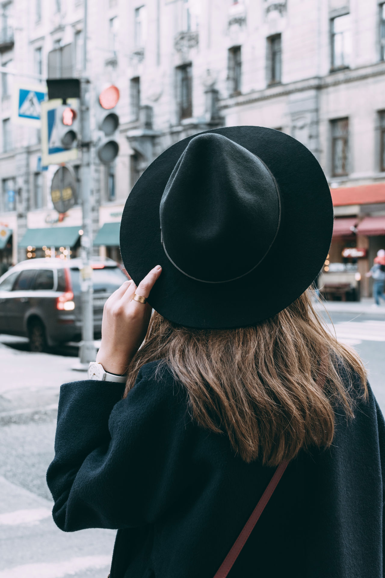 Black Hair Casual Clothing City City Life City Life Hat Holding Lifestyles Long Hair Modern One Woman Only Outdoors People And Places Person Rear View Street Unrecognizable Person Urban Walk Woman