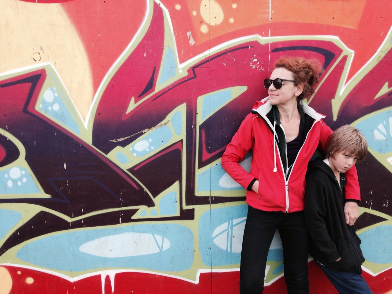 mother and son Boy Cool Education Freedom Graffiti Graffiti Art Jacket Looking Forward Mother Motherandson  Orange Color Parent Red Hair Son Wall - Building Feature