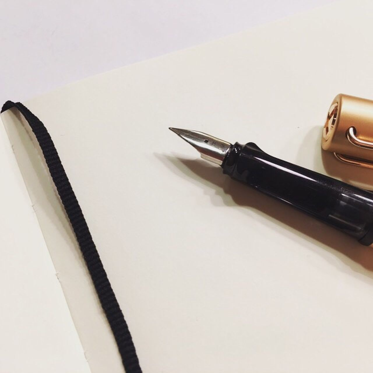 still life, pen, table, close-up, no people, fountain pen, studio shot, indoors, white background, nib, paper