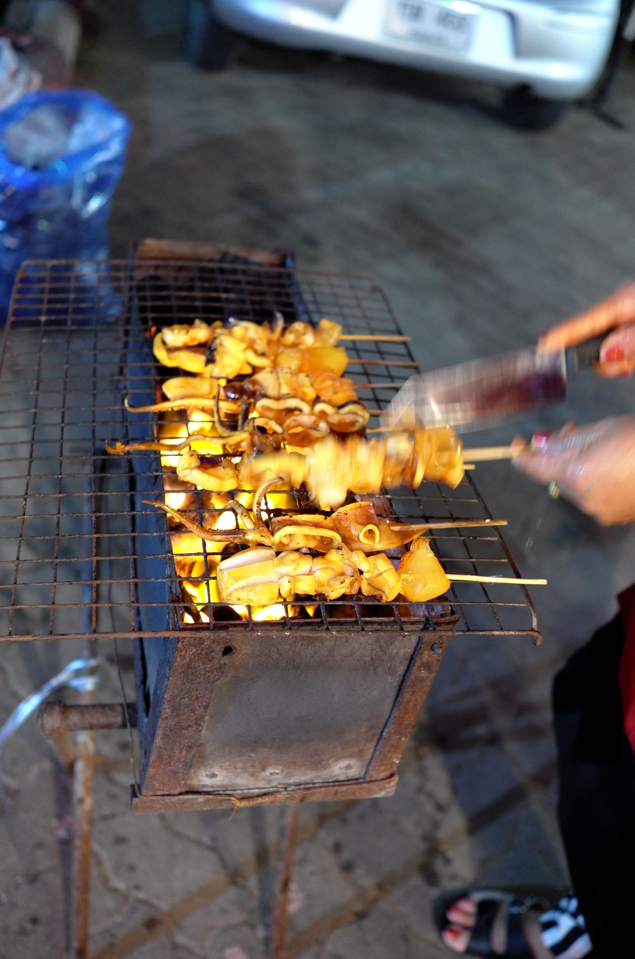 Barbecue Barbecue Grill Close-up Food Food And Drink Freshness Gril Grilled Human Body Part Human Hand Men Metal Grate Night Octopus One Person Outdoors People Real People Skewer Street Food Yellow