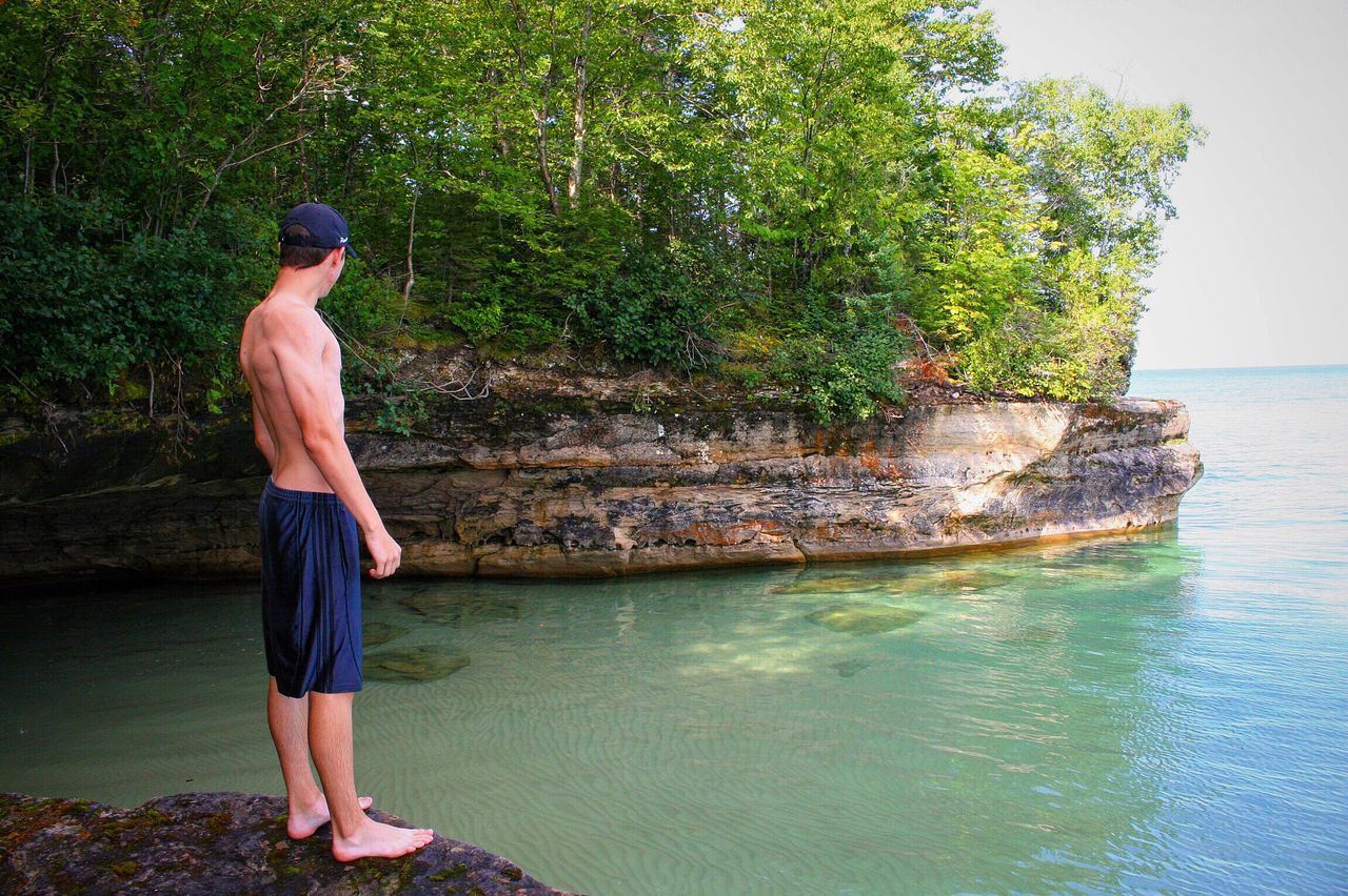 Full Length Water Tree Outdoors Standing Vacations Day Nature One Person Summer Sea Real People Scenics Beauty In Nature Beach People Adult Adults Only One Man Only