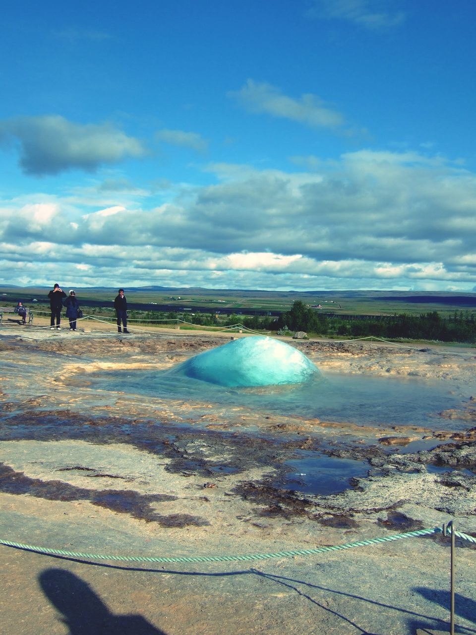 People At Fountain Geyser Against Sky