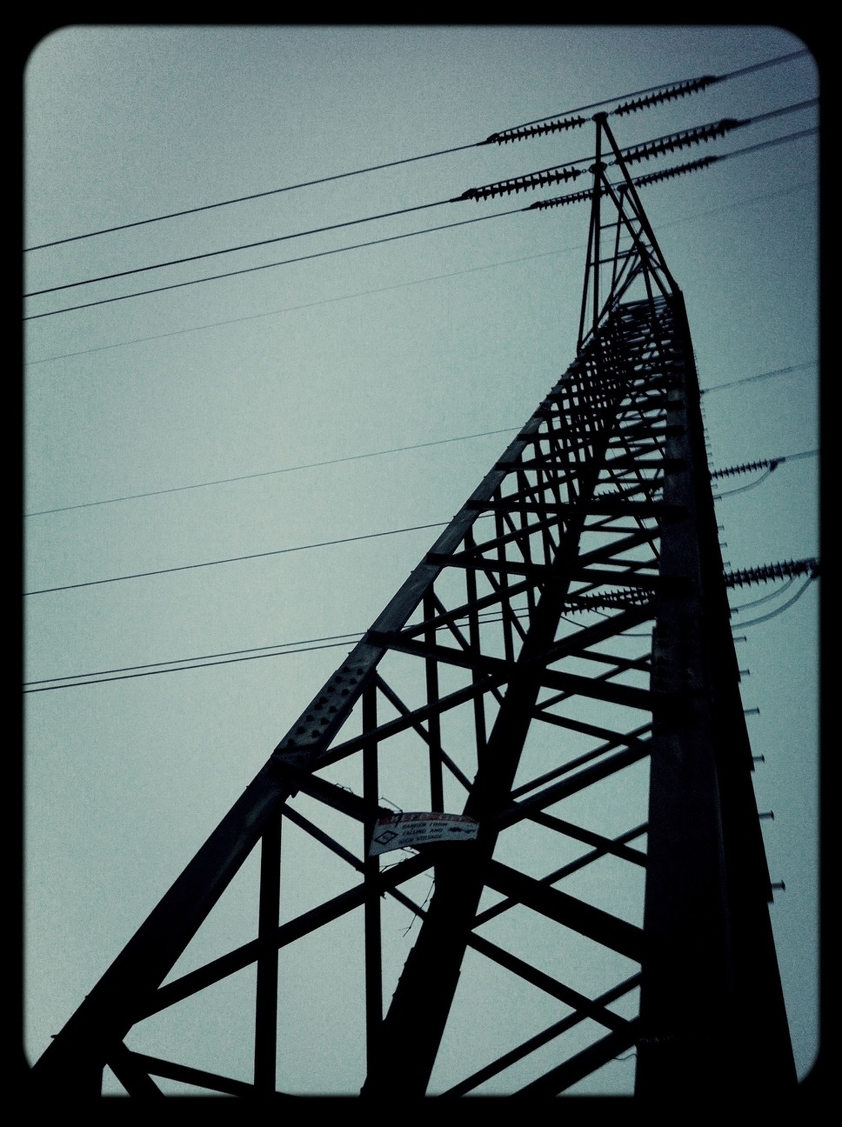 power line, electricity pylon, low angle view, connection, power supply, electricity, transfer print, fuel and power generation, cable, silhouette, technology, sky, auto post production filter, clear sky, power cable, built structure, no people, outdoors, sunset, day