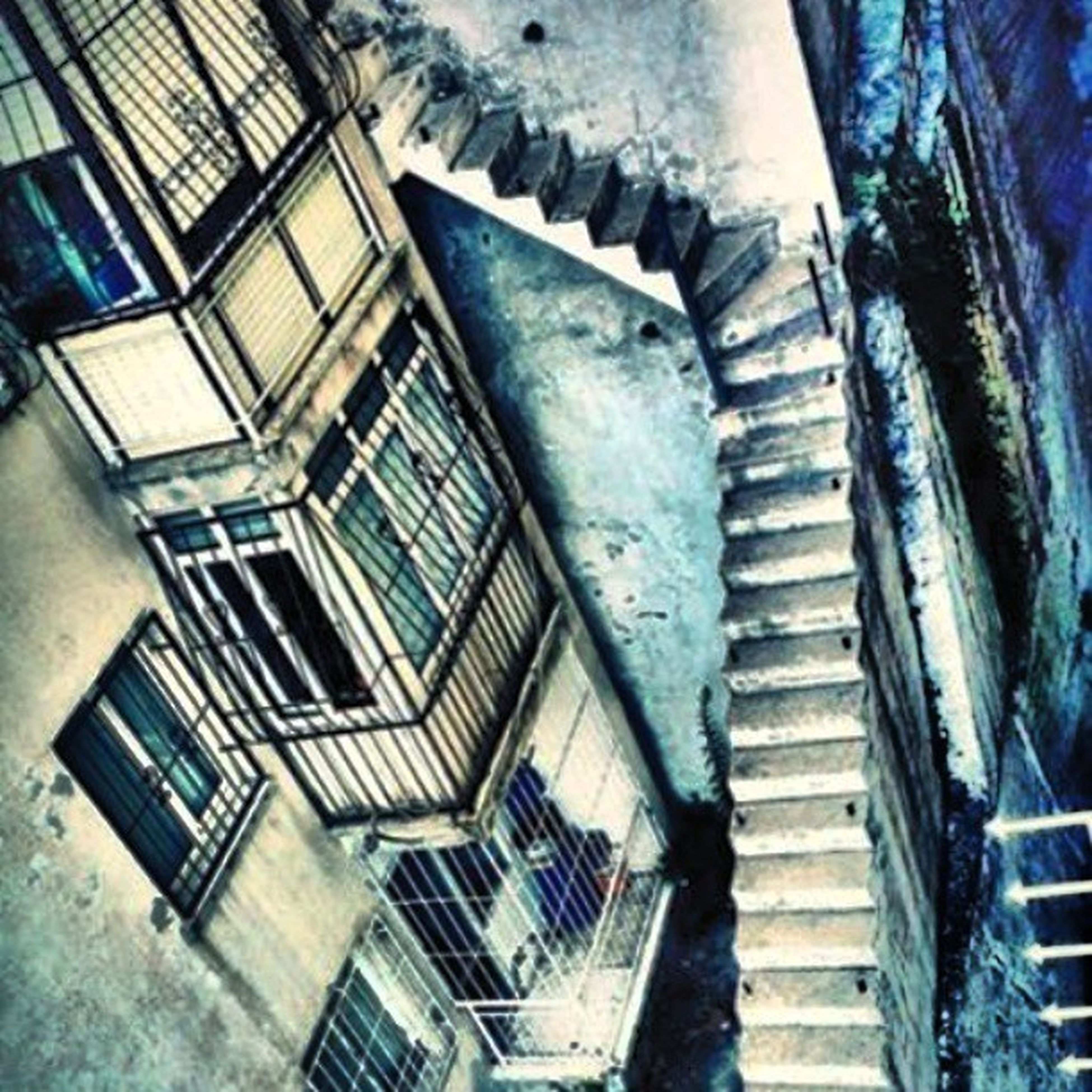 architecture, built structure, building exterior, low angle view, window, steps, building, staircase, steps and staircases, railing, house, old, residential structure, abandoned, residential building, wall - building feature, weathered, damaged, day, door