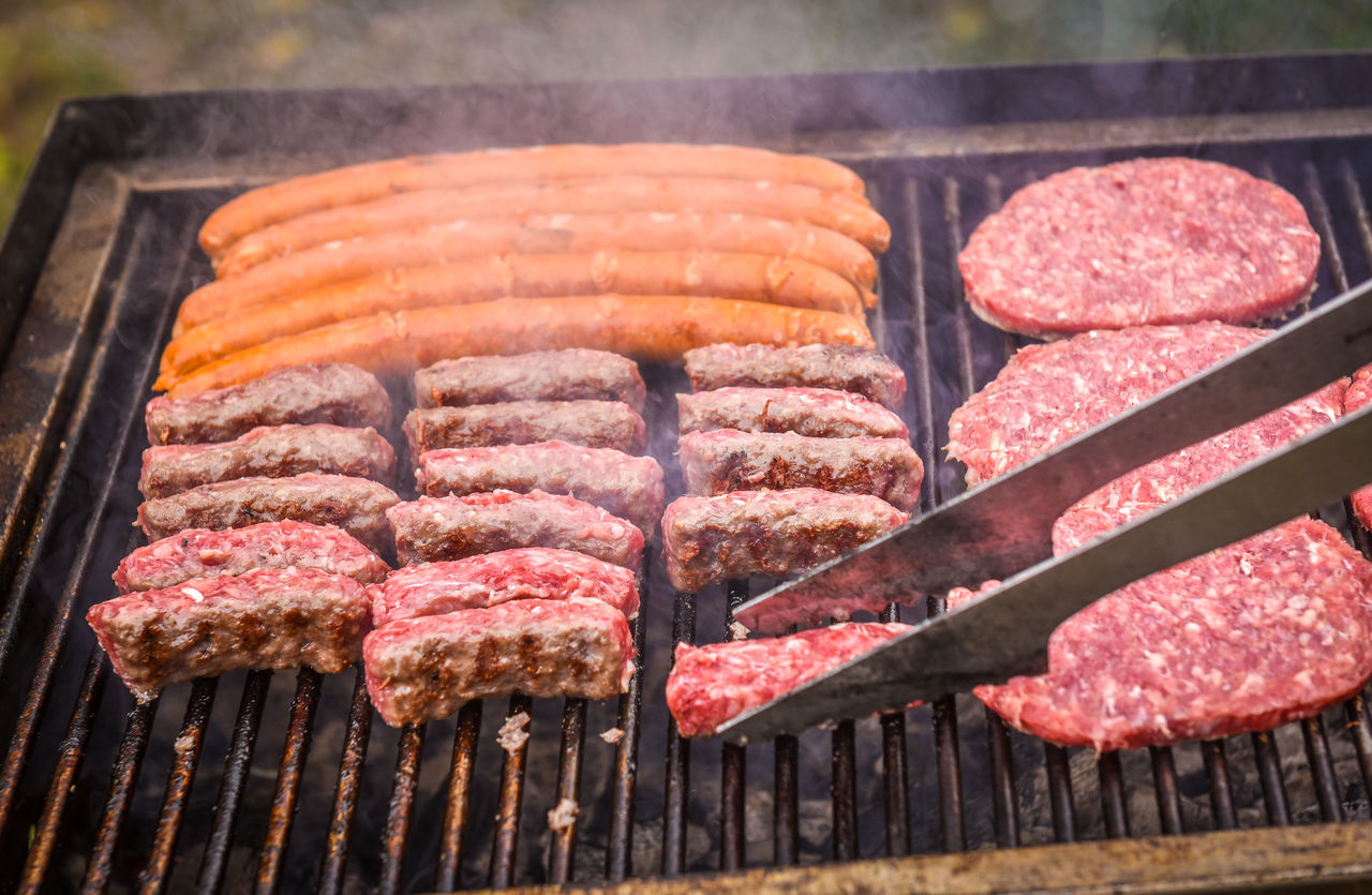 Grilling Meat on barbecue grill with coal. Cevapcici, burgers and sausages on charcoal barbecue BBQ in the nature Backgrounds Barbecue Barbecue Grill BBQ Beef Cevapcici Chic Food Food And Drink Freshness Grilled Hot Making Music Meat Picknik Pork Preparing Food Red Rib SLICE Stem Sunset Unhealthy Eating Wing Wings