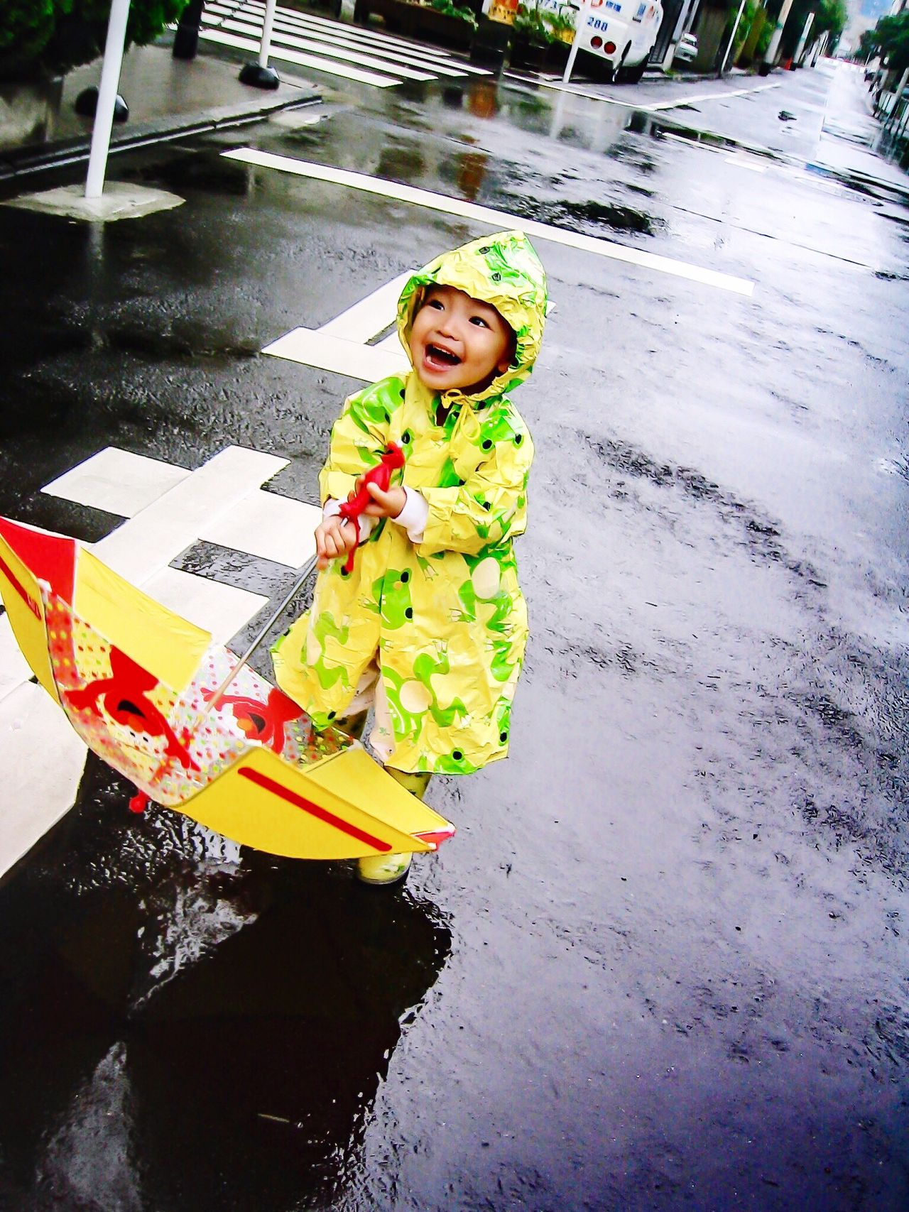 Singing in the rain Singing Singing In The Rain Rainy Days Rain Umbrella Raincoat Toddler  Boy Smile Big Smile Happy Happy People Cheerful Cheerfulness