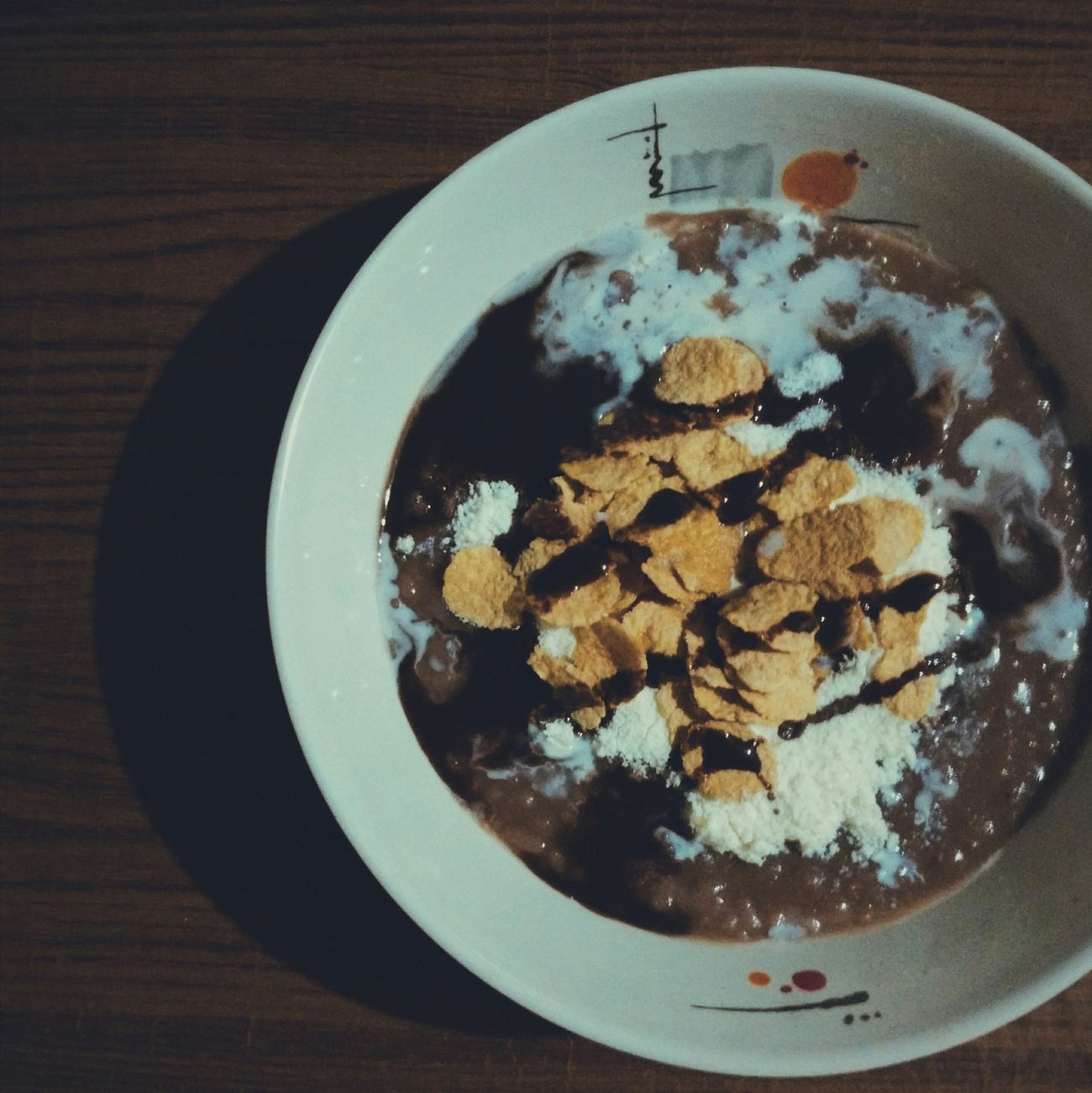 "Food Porn Awards a chocolate rice porridge I made for breakfast. Commonly known as ""Champorado"", a breakfast meal in the Philippines, I added some cornflakes and hershey's syrup as a spin off. Food Porn Foodie Foodphotography Champorado"