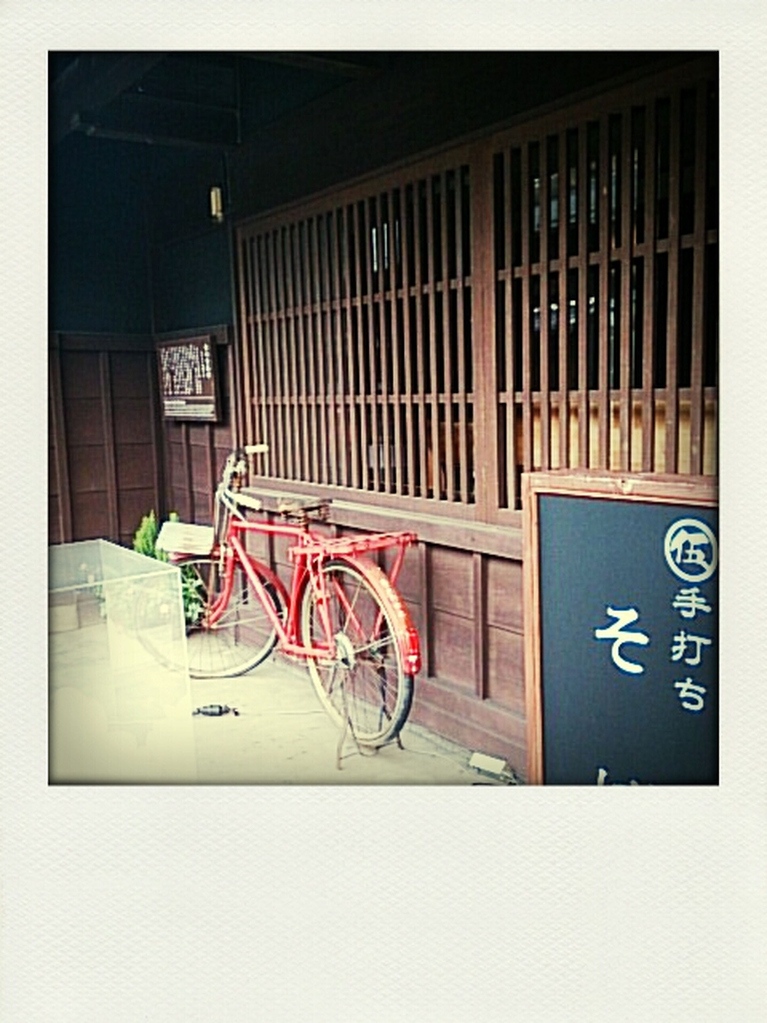 transfer print, bicycle, architecture, built structure, building exterior, auto post production filter, parked, stationary, absence, land vehicle, parking, transportation, no people, house, empty, window, wall, wall - building feature, indoors, day