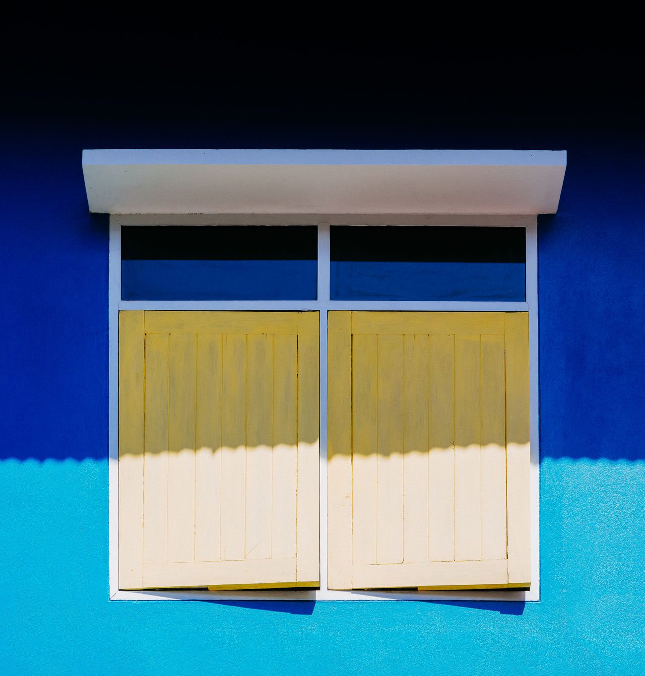 light and shadow Architecture Blue Day Multi Colored No People Shadow Shadows & Lights Shutter Window Yellow
