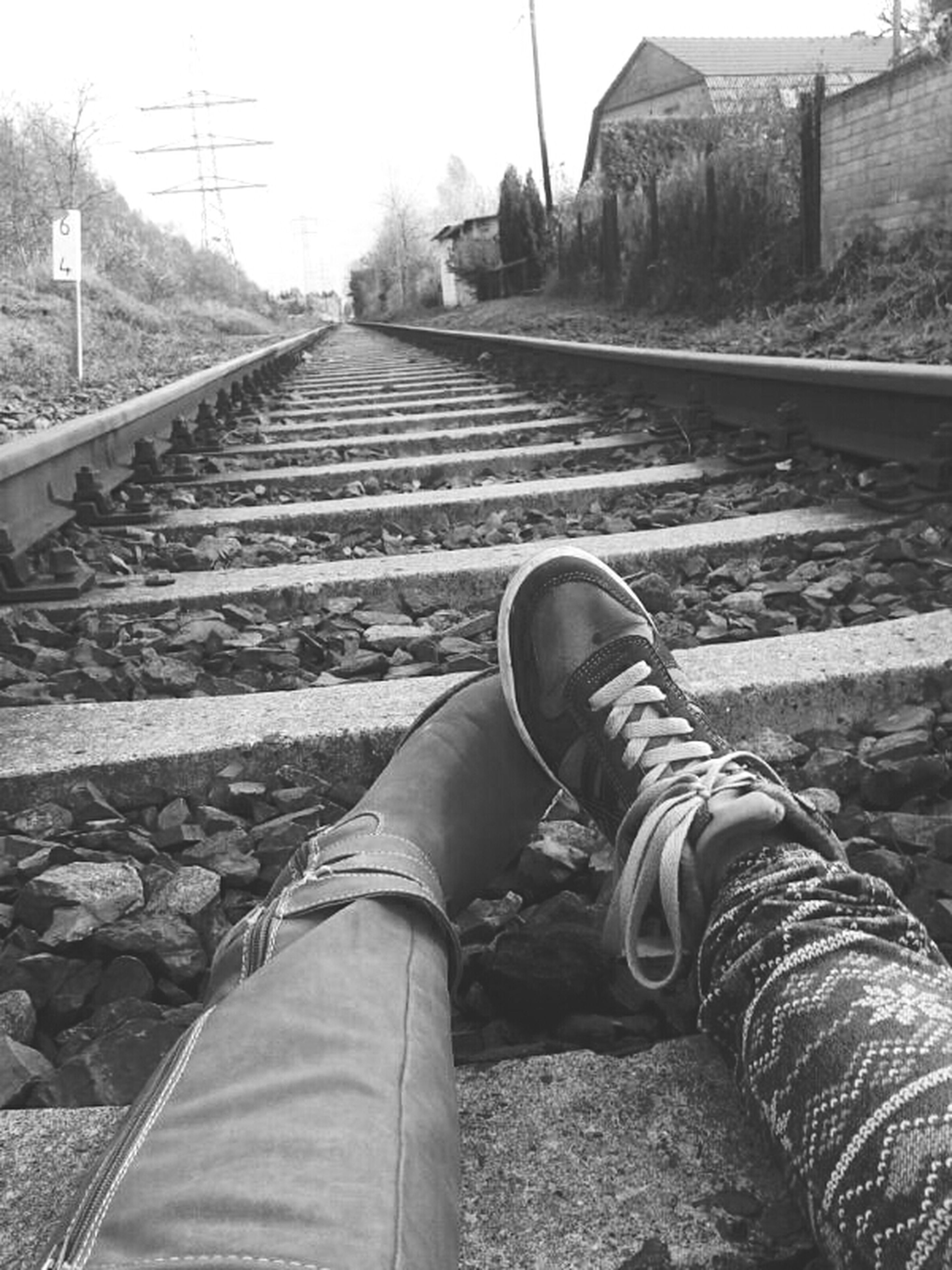 railroad track, the way forward, transportation, low section, rail transportation, personal perspective, person, diminishing perspective, men, vanishing point, travel, shoe, lifestyles, day, unrecognizable person, outdoors, railway track