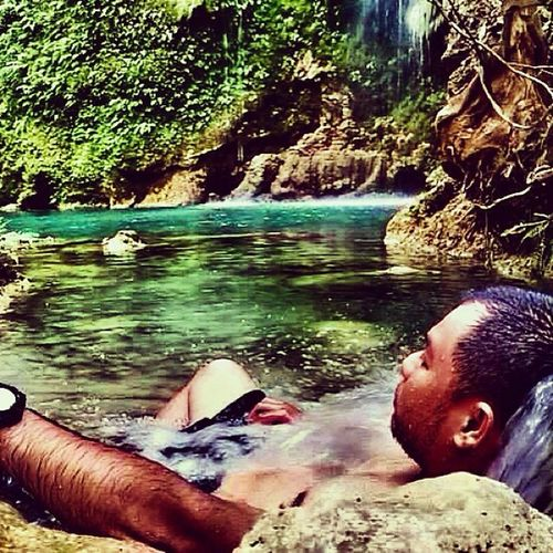 Submerged in the cold water of Batlag Falls BiglaangTravel TanayRizal