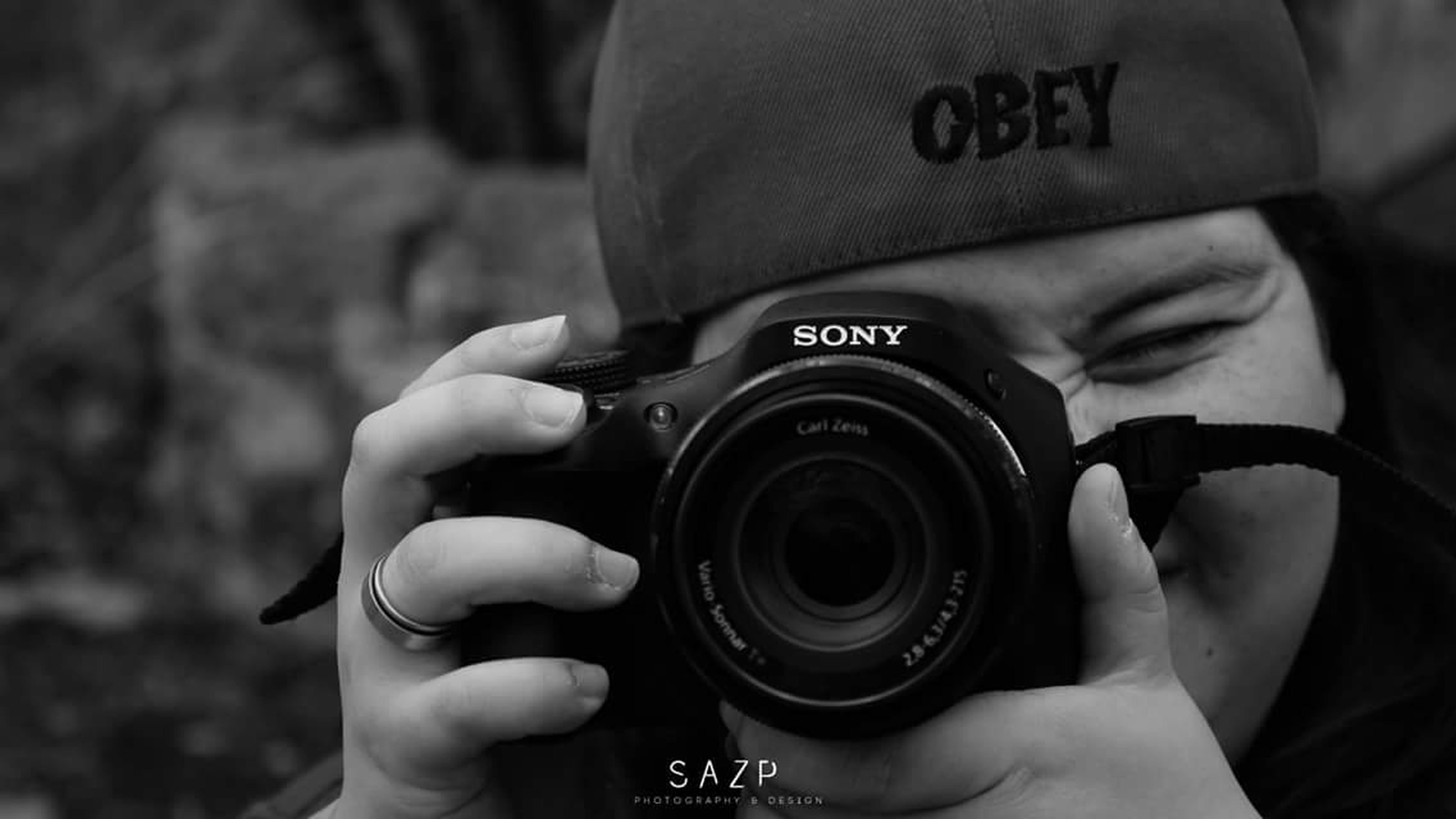 holding, photography themes, photographing, person, communication, lifestyles, camera - photographic equipment, men, leisure activity, technology, digital camera, focus on foreground, part of, text, cropped, smart phone, wireless technology, close-up