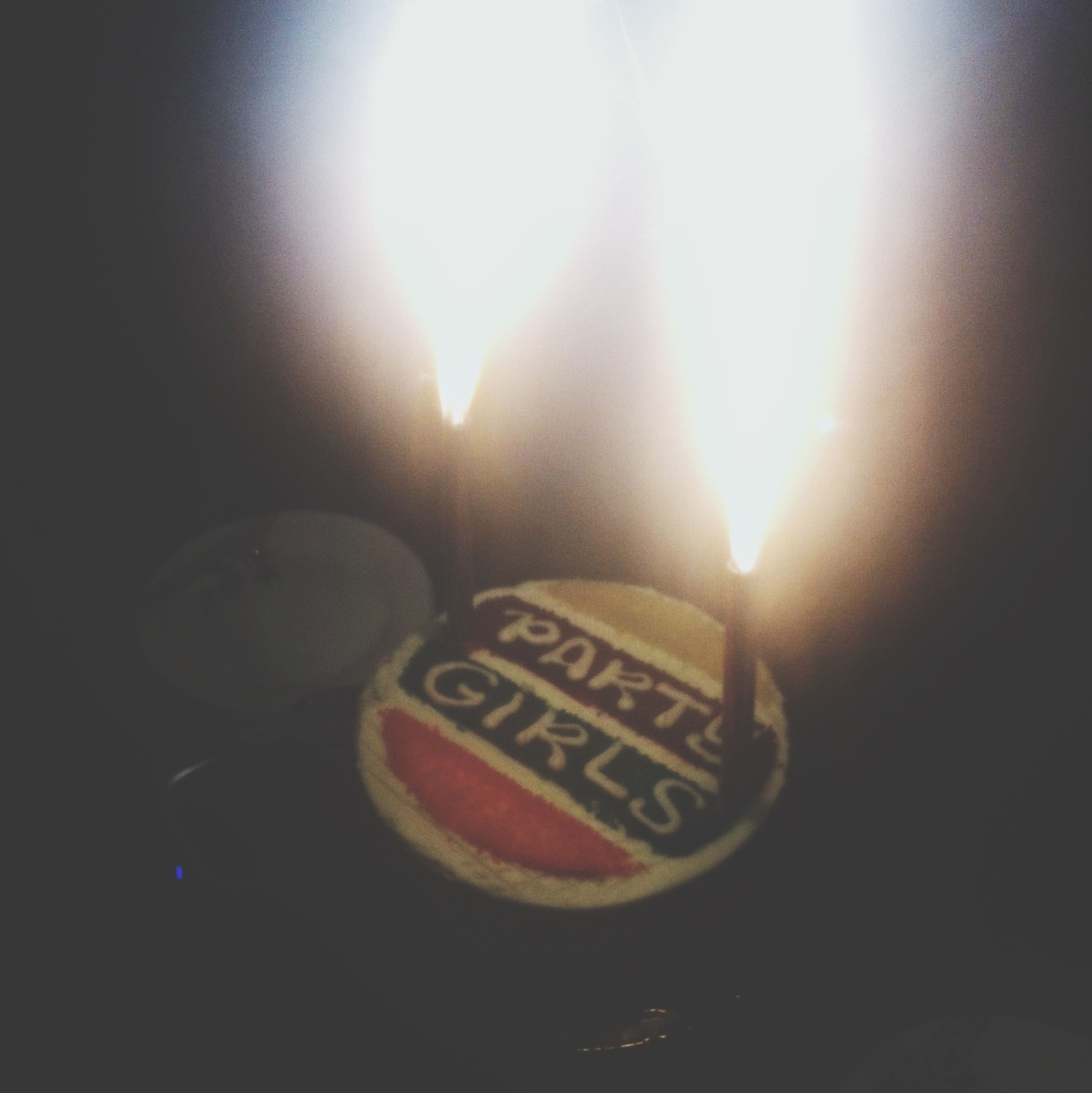 indoors, text, close-up, still life, western script, no people, glowing, candle, burning, art, communication, illuminated, art and craft, flame, creativity, sunlight, human representation, heat - temperature, single object, table