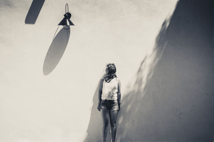 thgil mid • Dim Light Mid Lightning Shade Shades Of Grey Shadows & Lights Shade And Shadow Light And Shadow Posing Modeling Shoulders on the White Wall White Background One Person Shadow FUJIFILM X-T10 Fujixseries Street Photography Quite Street Shadow Photography The Week On EyeEm La Geria