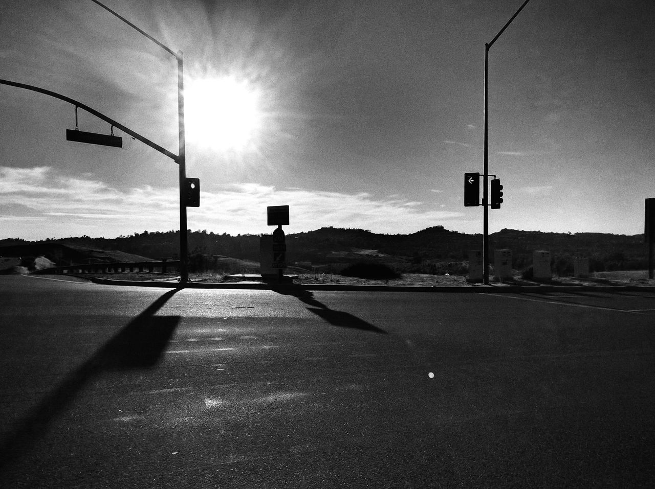 which way do we go ? Road The Way Forward No People Mobile Photography Eyem Gallery Intersection On The Road In A Car EyeEm Gallery Stoplights Street Signs Bnw Black And White Photography EyeEm Bnw Looking For Inspiration Black And White Collection  Mountains And Sky Silouette & Sky Shadows & Lights