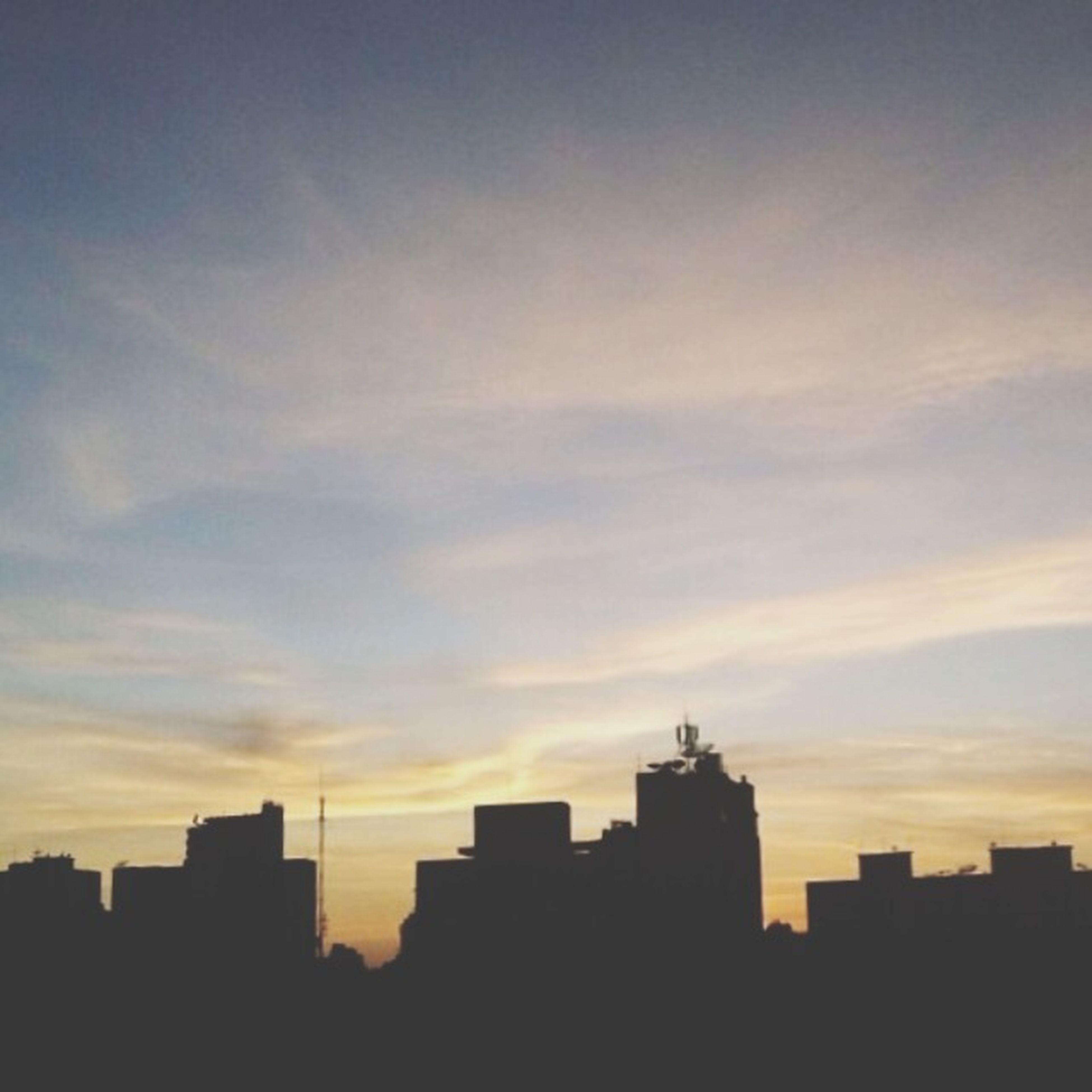building exterior, architecture, sunset, built structure, silhouette, sky, city, orange color, building, cloud - sky, residential structure, residential building, cityscape, cloud, low angle view, outdoors, no people, outline, nature, dusk