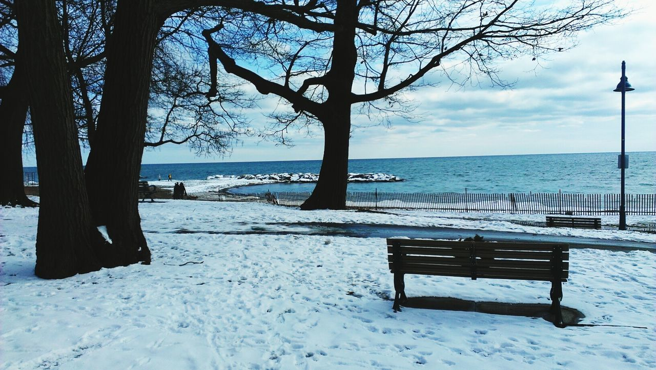 Bench At Snowy Seaside