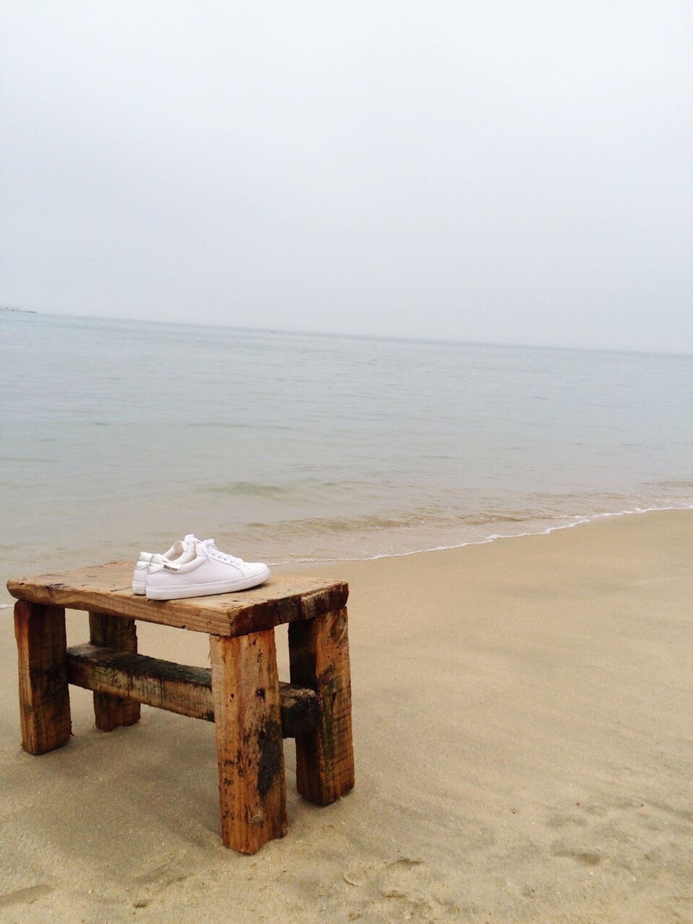 sea, horizon over water, beach, water, sand, tranquil scene, tranquility, wood - material, scenics, shore, clear sky, copy space, absence, beauty in nature, nature, empty, chair, sky, wooden, idyllic