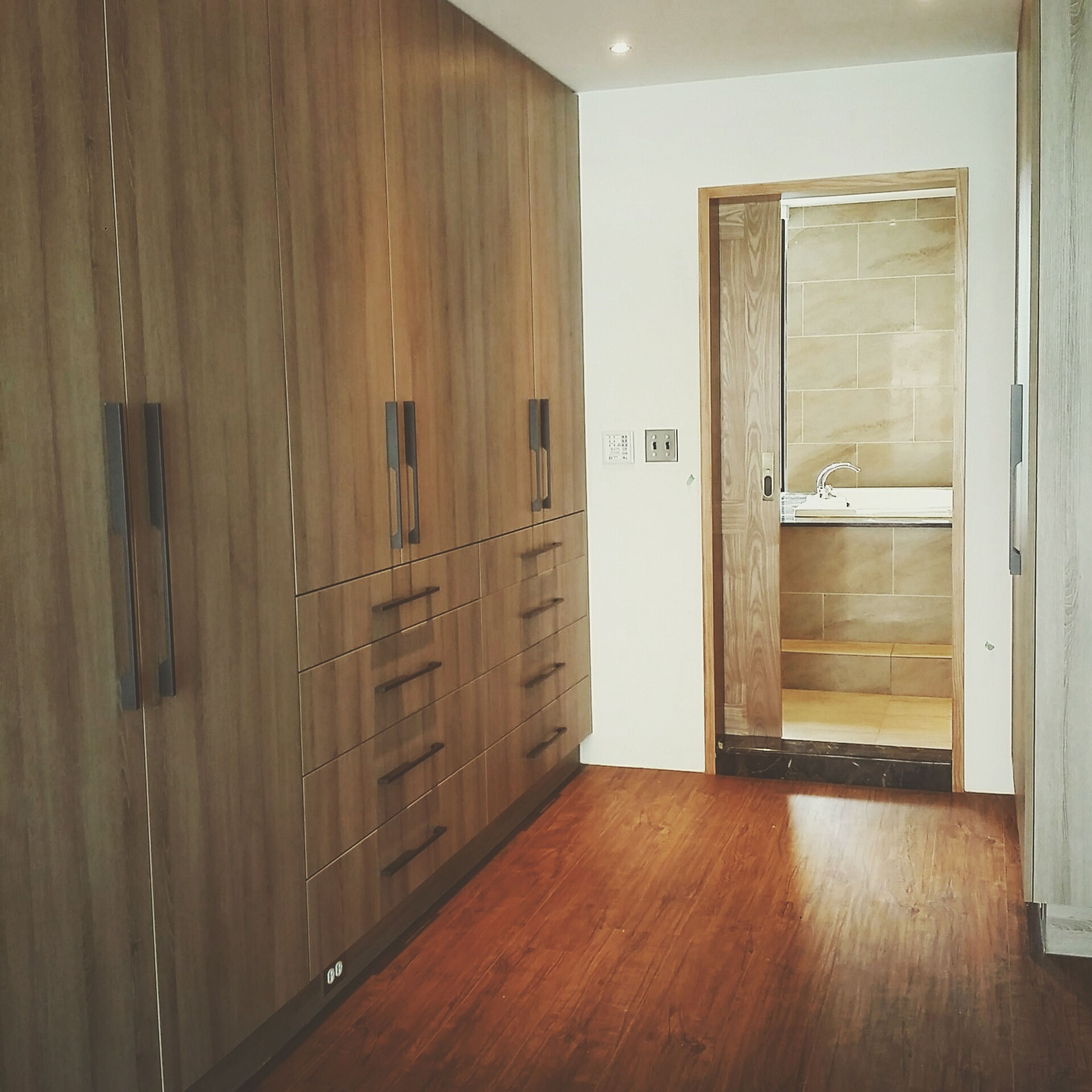indoors, window, home interior, door, empty, absence, flooring, glass - material, wood - material, domestic room, hardwood floor, house, table, built structure, architecture, reflection, no people, transparent, open, curtain