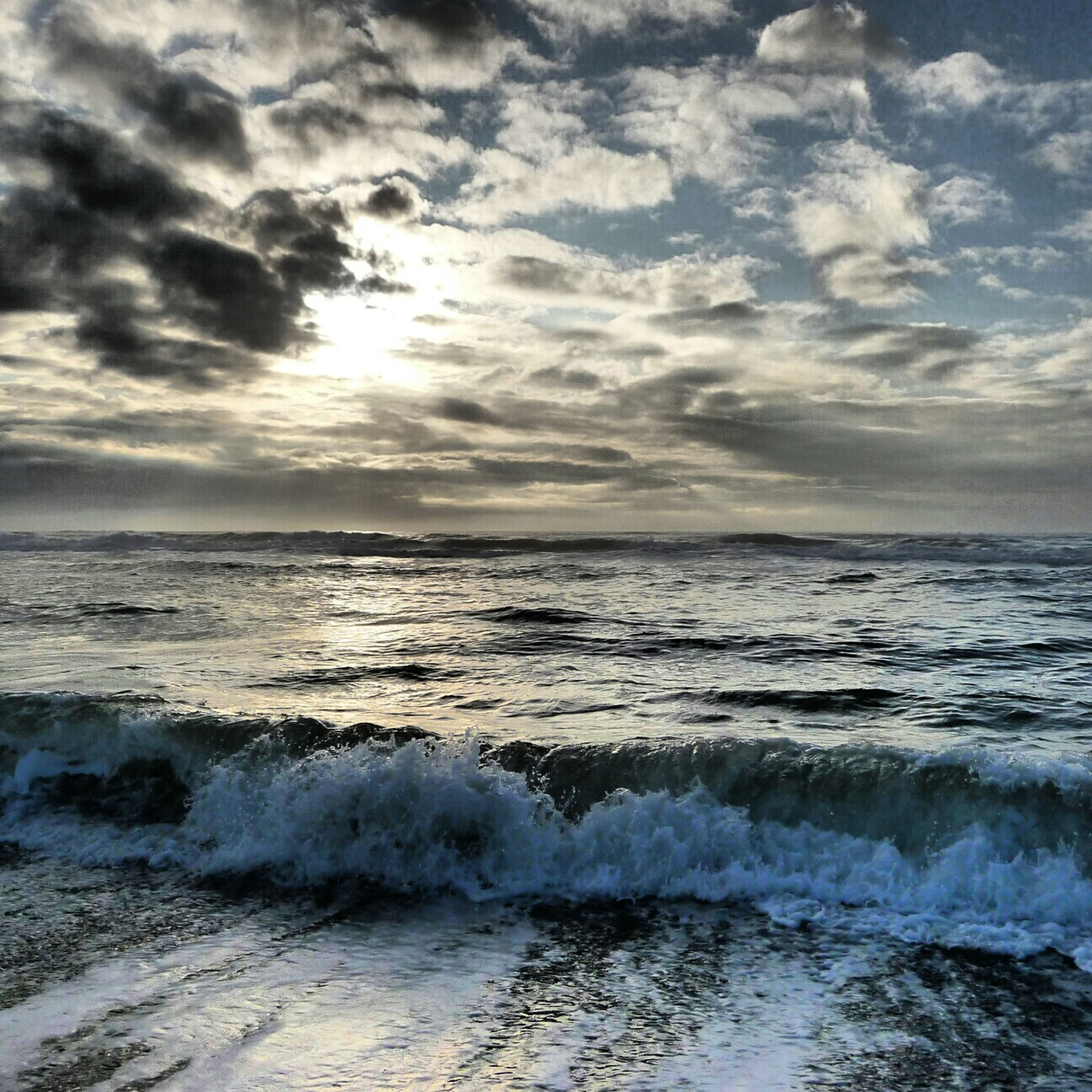 water, sea, sky, horizon over water, scenics, cloud - sky, beauty in nature, wave, tranquil scene, tranquility, beach, cloudy, nature, surf, shore, cloud, idyllic, weather, motion, outdoors