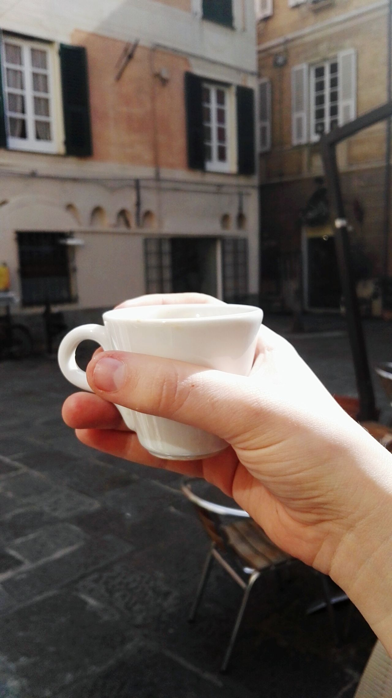 Albenga Architecture Architecture Building Exterior Built Structure Close-up Coffee Cropped Day Espresso Focus On Foreground Holding Human Finger Italy Leisure Activity Lifestyles Men Part Of Person Personal Perspective Street Unrecognizable Person