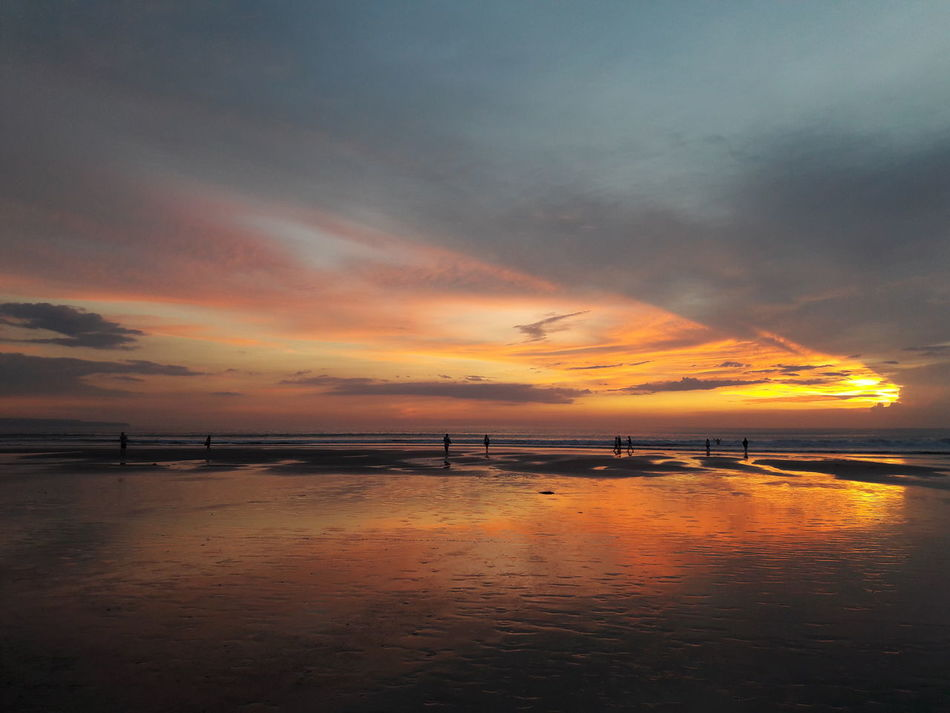 Sunset Colors Dramatic Sky Sunset Outdoors Reflection Beauty In Nature Sea Beach No People Horizon Over Water Bali Beach Bali, Indonesia Sunsetphotographs Nofilters NoEdits