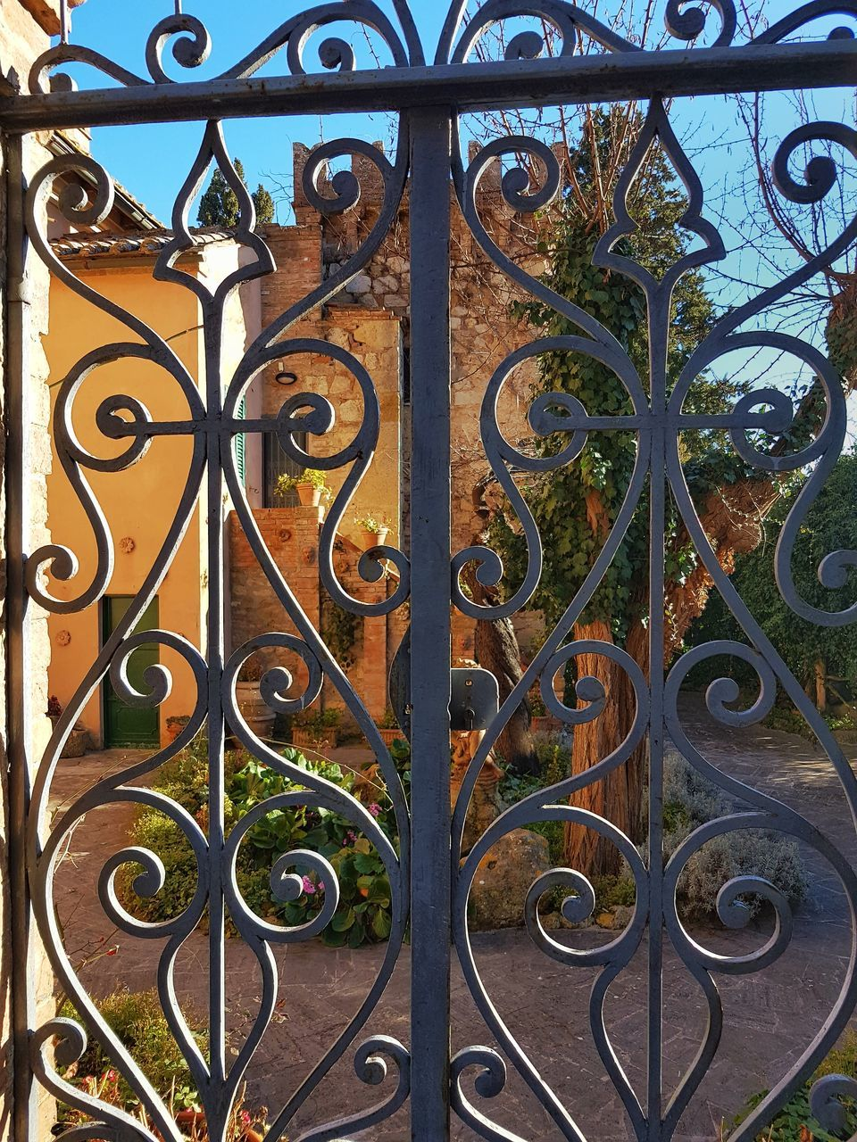 metal, gate, wrought iron, design, ornate, pattern, door, day, gold colored, outdoors, no people, cast iron, metal grate, architecture, close-up, building exterior
