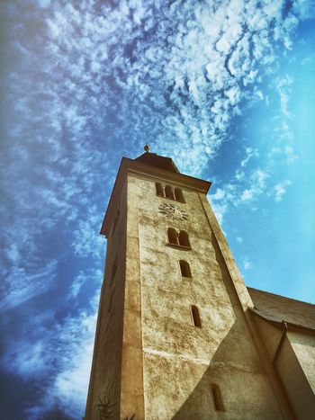 Architecture Built Structure Building Exterior Low Angle View Blue Sky Window Tower Cloud - Sky Tall - High Outdoors Day History Tall No People High Section Office Building