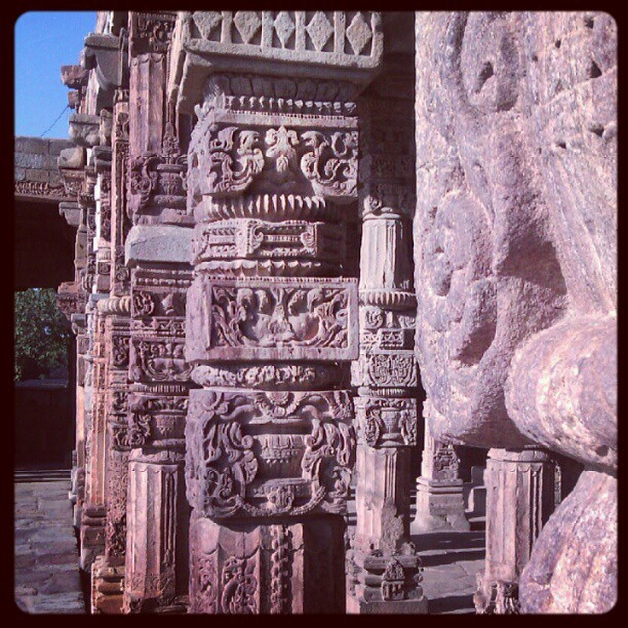 sculpture, art and craft, statue, ancient, history, carving - craft product, carving, religion, human representation, architecture, bas relief, built structure, outdoors, place of worship, day, travel destinations, spirituality, building exterior, no people, ancient civilization, close-up, sky