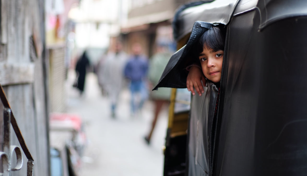 a curious girl in the rickshaw Adult Adults Only City Day Mode Of Transport One Person One Woman Only Outdoors People Rickshaw Srinagar Kashmir Transportation Young Adult