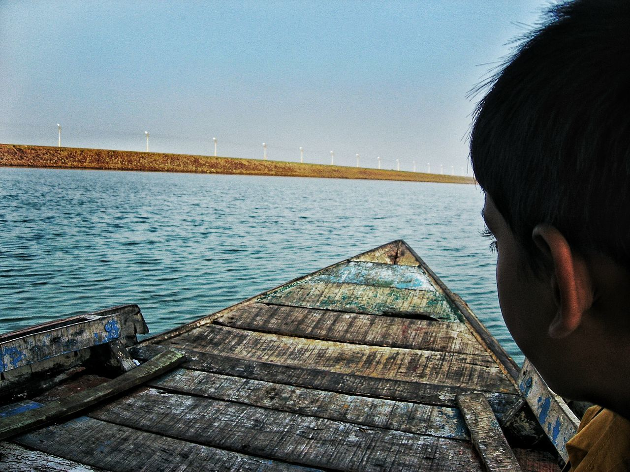sea, water, pier, wood - material, clear sky, real people, one person, day, outdoors, sky, headshot, nature, boys, men, childhood, wood paneling, horizon over water, close-up, people