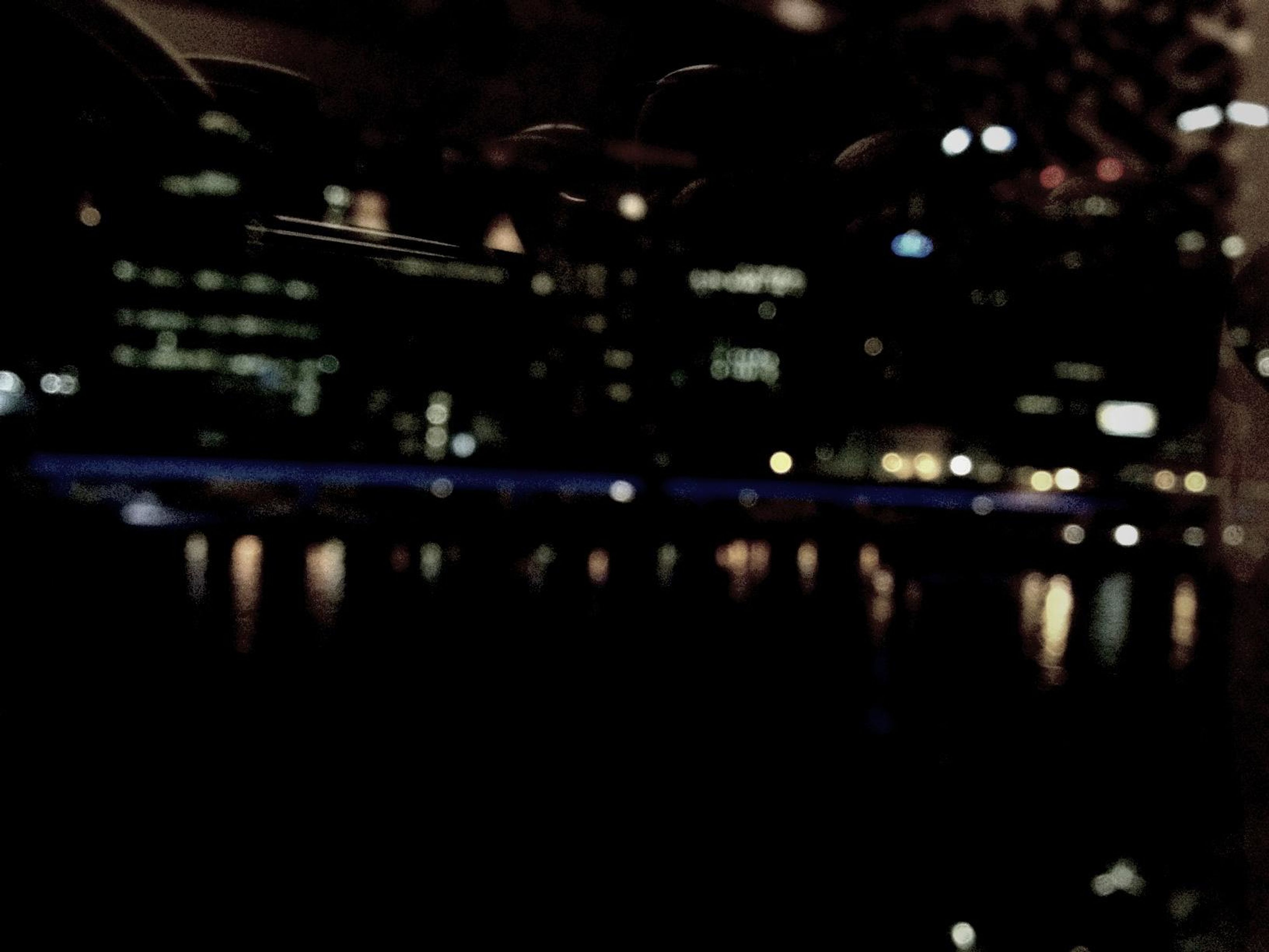 water, night, illuminated, reflection, river, transportation, waterfront, focus on foreground, outdoors, built structure, building exterior, architecture, no people, dark, nautical vessel, mode of transport, lake, city, close-up, nature