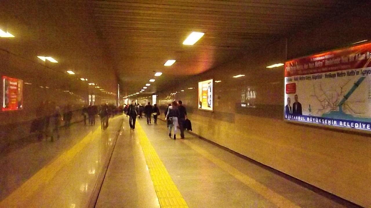 illuminated, lighting equipment, ceiling, underground, indoors, subway station, real people, men, people