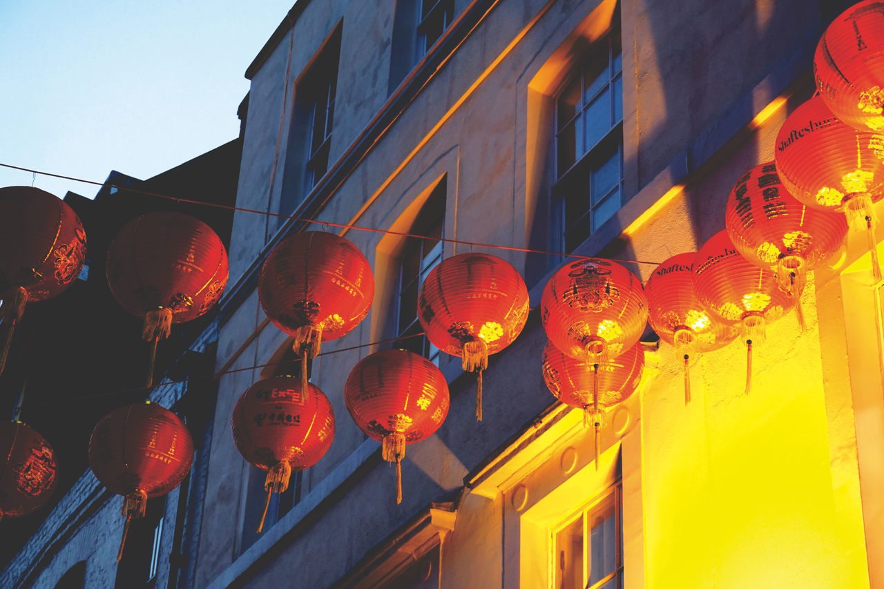 Illuminate // Sony a6000 // Architecture Building Exterior Built Structure China Chinese Lantern Chinese Lantern Festival Chinese New Year City Contrast Cultures Hanging Illuminated Lantern Light Lighting Equipment London Low Angle View Orange Red Reflection Sky Sony A6000 Text This Week On Eyeem The City Light Minimalist Architecture