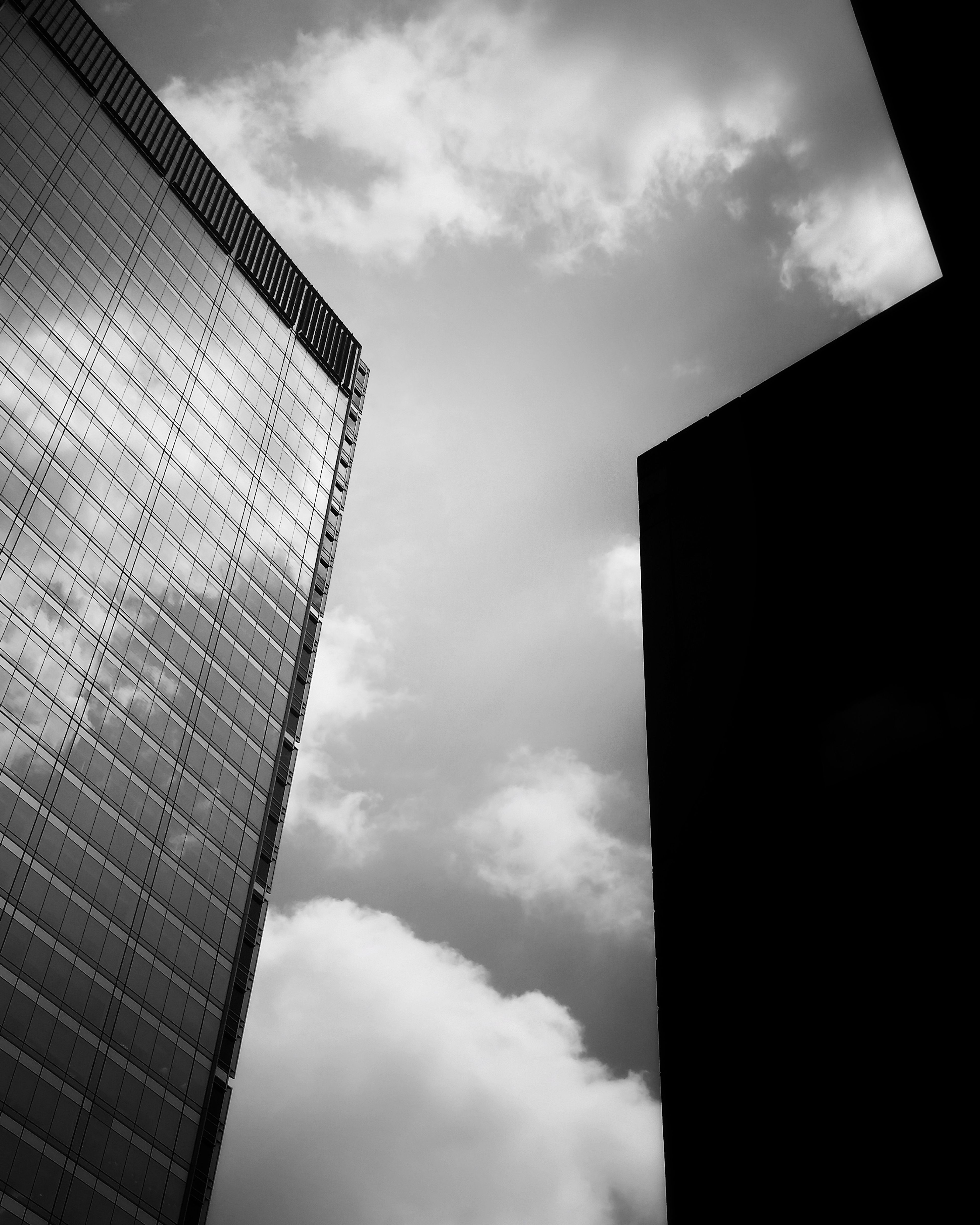 Out of the darkness... Skyscraper Low Angle View Architecture Building Exterior EyeEmbestshots EyeEm Gallery Bnw_friday_challenge Bnw_life Negative Space Bnw_friday_eyeemchallenge Composition Bnw Photography Bnw_collection Bnw_worldwide Monochrome EyeEm Best Shots Rule Of Thirds Lines And Shapes Bnw_society Shadow And Light Architectural Photography Skyporn Architecture Architecture Photography Whitespace