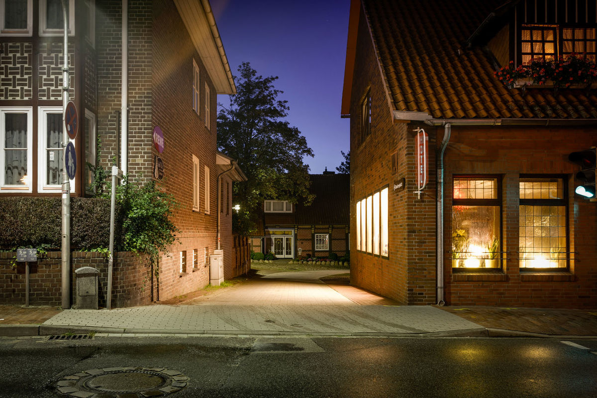 Architecture Building Building Exterior Built Structure Diminishing Perspective House Illuminated Night Photography Outdoors Province Provincetown  Rear House Red Bricks Remote Village Residential Building Cities At Night The Architect - 2016 EyeEm Awards Shadow Sidewalk Small Hotel Street Suburban Sunlight The Way Forward Window