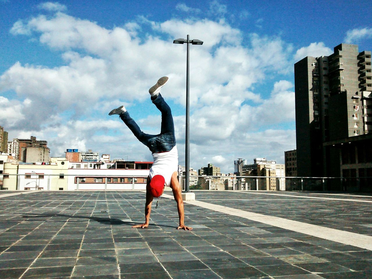 The City Light one person City outdoors performance Cityscape sky motion full length EyeEm Best Shots Breakdancing Hip Hop EyeEm gallery eyeemphotography VSCO Venezuela Capture The Moment Fresh on Market 2017
