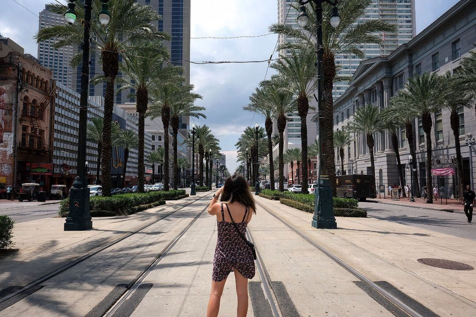 New Orleans Architecture Building Exterior Built Structure City Rear View Street Lifestyles Young Women Person City Life Sky Tower Woman Taking Picture Casual Clothing Long Hair Footpath Young Adult Day Outdoors Tall - High Streetcar Canal Street Photagrapher Fujifilm XF16mmF1.4