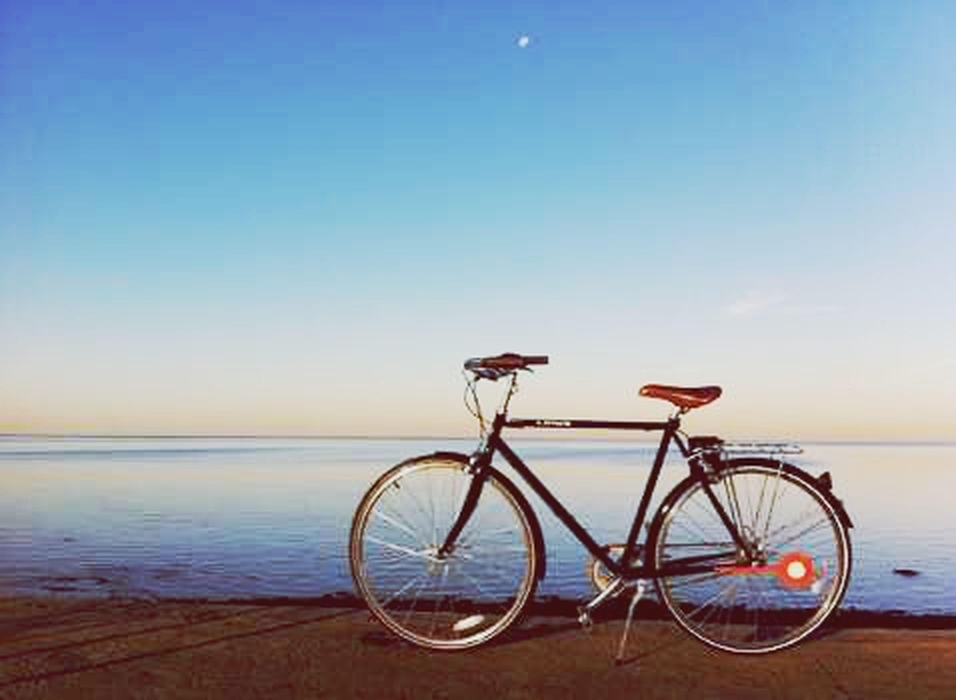 bicycle, transportation, mode of transport, water, sea, stationary, parked, parking, horizon over water, copy space, land vehicle, clear sky, tranquility, blue, beach, tranquil scene, sky, beauty in nature, nature, scenics