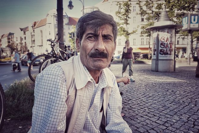 We met today in Hermannplatz, sitting next to each other; me staring at my phone, him observing the platz. Then we had a lovely yet chaotic chat. He has been in Germany for 8 months now and doesn't know if his family will be able to join. His German is very bad, he says, and language is everything here. Still, he was smiling most of the time and that is universal. Berlin City City Life City Street Focus On Foreground Hermannplatz Natural Light Portrait Portrait Portraits Real People Refugeeswelcome Street Photography
