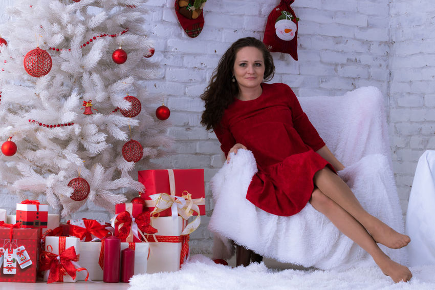 Christmas Red Beautiful People Portrait Only Women Beautiful Woman Looking At Camera Christmas Present One Woman Only Holiday - Event Long Hair Sitting Women Elégance EyeEm Selects Christmas Spirit Christmas Time Christmas Eve Christmas Party Anticipation Be. Ready.