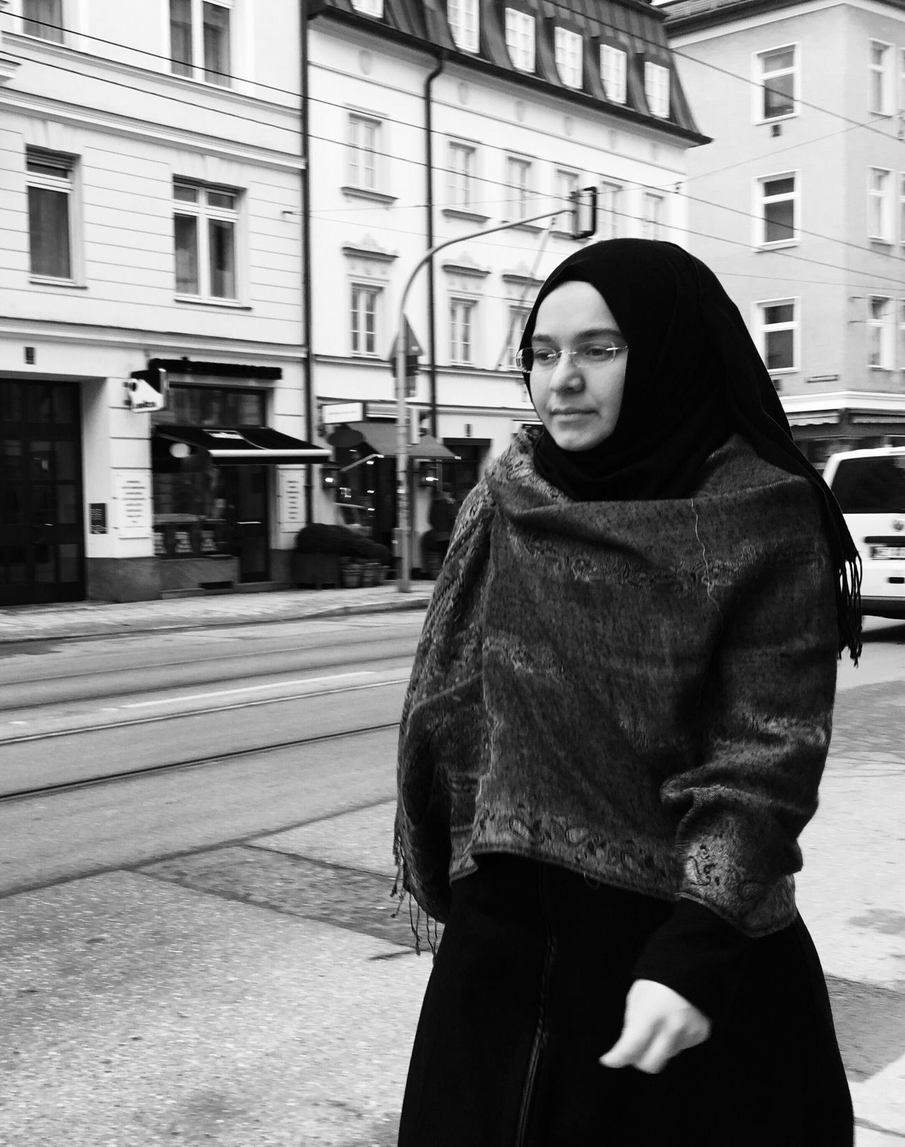 Three Quarter Length Building Exterior Real People One Person Built Structure Lifestyles Black And White Street Focus On Foreground Leisure Activity Young Adult Warm Clothing Young Women Outdoors Front View City Day Overcoat Beautiful Woman Standing