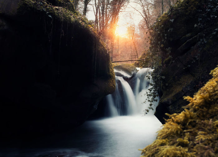 Beauty In Nature Day Motion Nature No People Outdoors River Rock - Object Scenics Stream - Flowing Water Sunlight Tranquil Scene Tranquility Travel Destinations Tree Vacations Water Waterfall