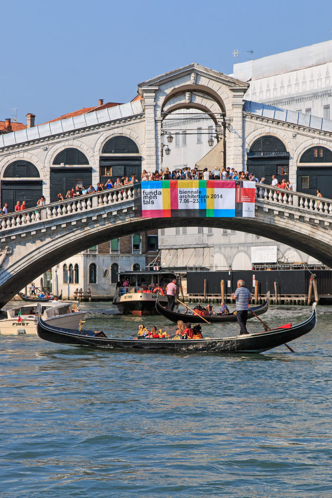 Venice, Italy - June 28, 2014: Gondolas and small boats on the Grand Canal in Venice, Italy, close to Rialto bridge. Some tourists admiring the stunning view. Arch Architecture Blue Boat Built Structure Canal Culture Day Gondola Gondola Gondola - Traditional Boat Grand Canal Venice Mode Of Transport Nautical Vessel Outdoors Rialto Bridge Rialtobridge River Sky Sunset Tourism Travel Destinations Venice, Italy Water Waterfront