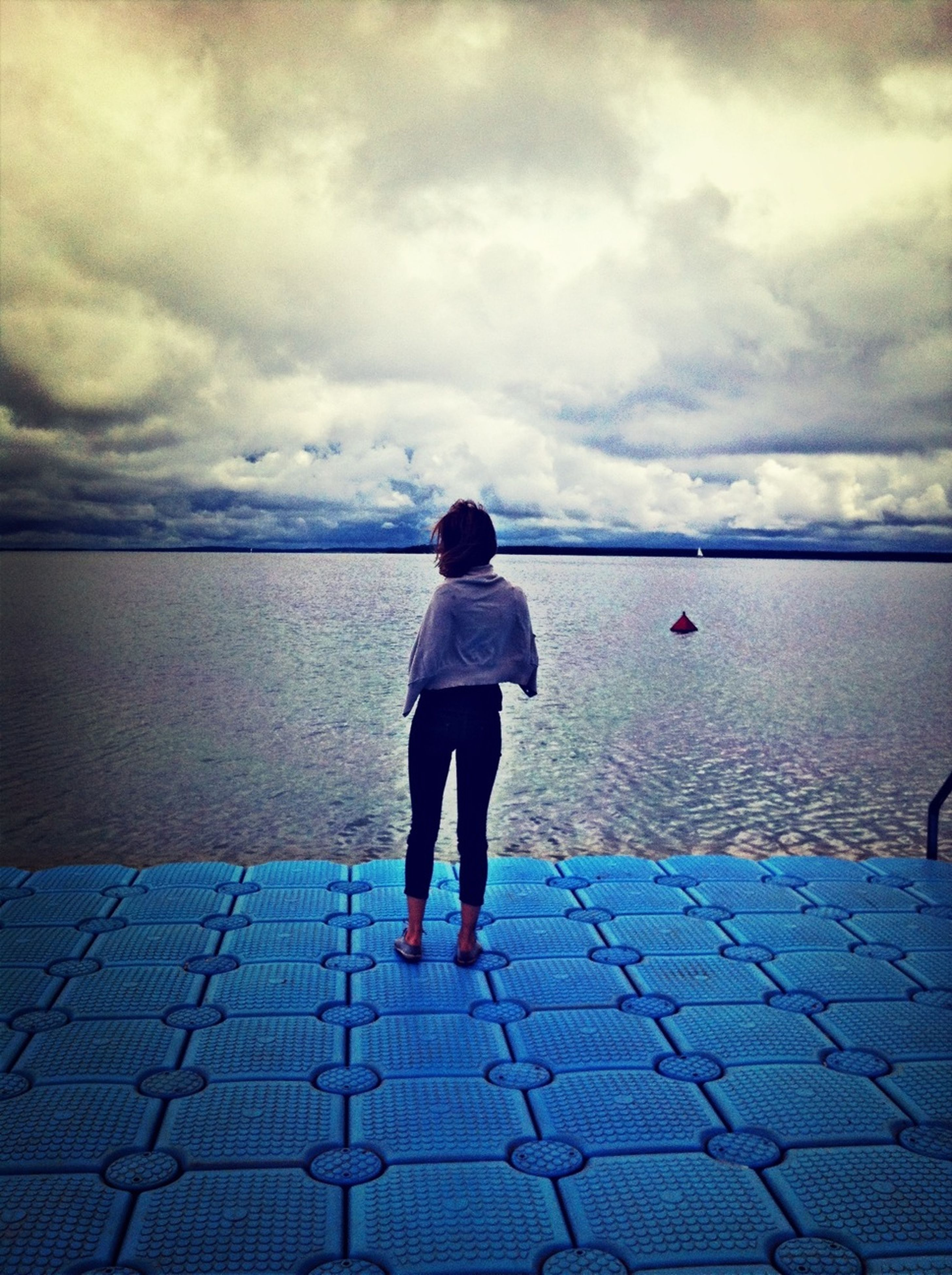 water, sky, full length, rear view, cloud - sky, standing, lifestyles, leisure activity, casual clothing, sea, cloudy, cloud, tranquility, nature, tranquil scene, pier, walking, day