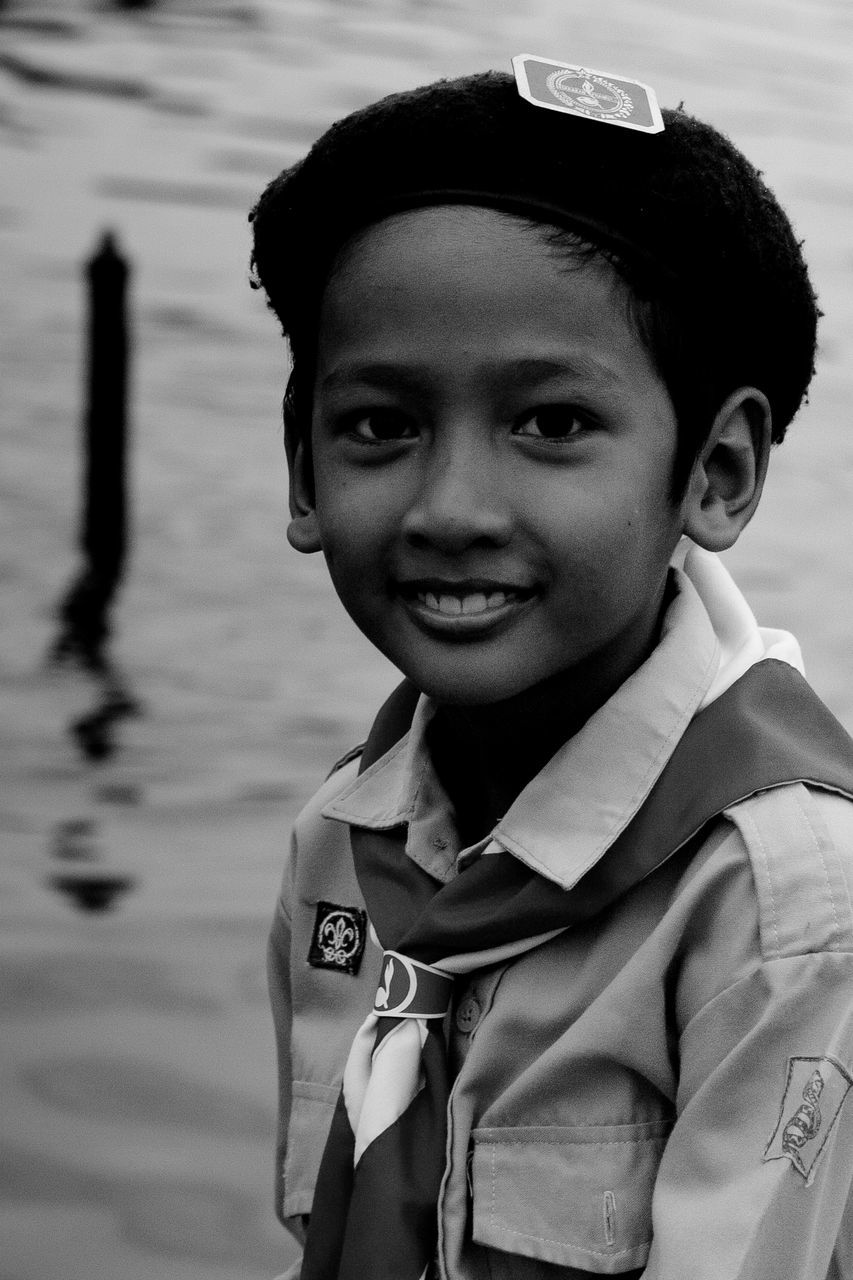 childhood, boys, looking at camera, portrait, real people, elementary age, one person, smiling, headshot, happiness, focus on foreground, day, outdoors, lifestyles, leisure activity, close-up, one boy only, nature, people