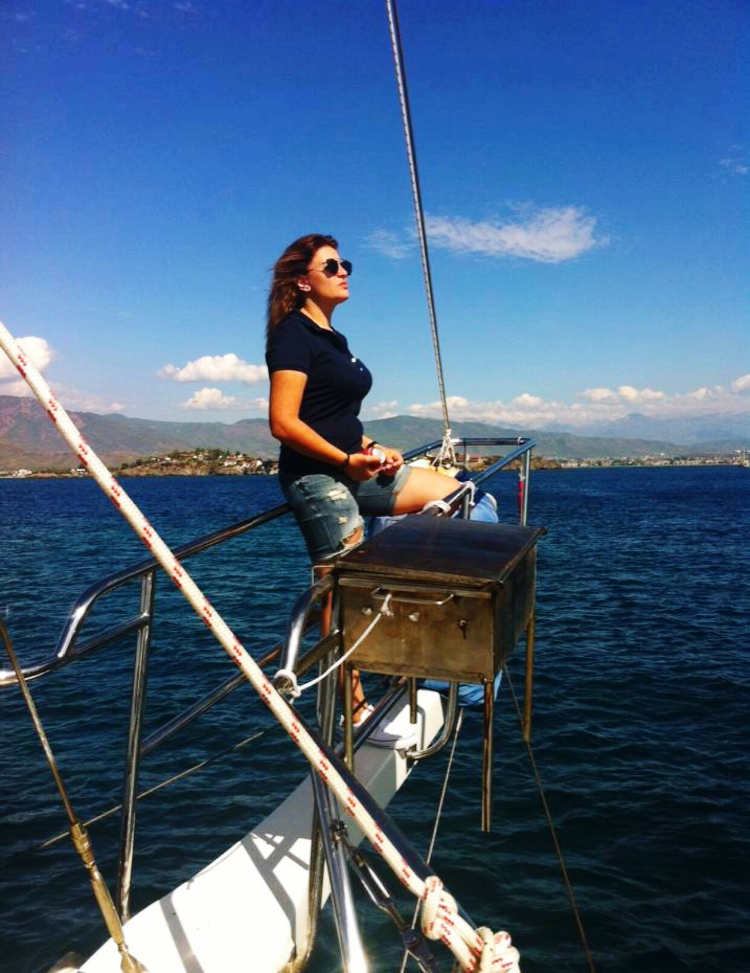 sea, water, nature, young adult, one person, sky, full length, horizon over water, sailing, young women, transportation, beauty in nature, nautical vessel, outdoors, real people, day, beautiful woman, fishing pole, people