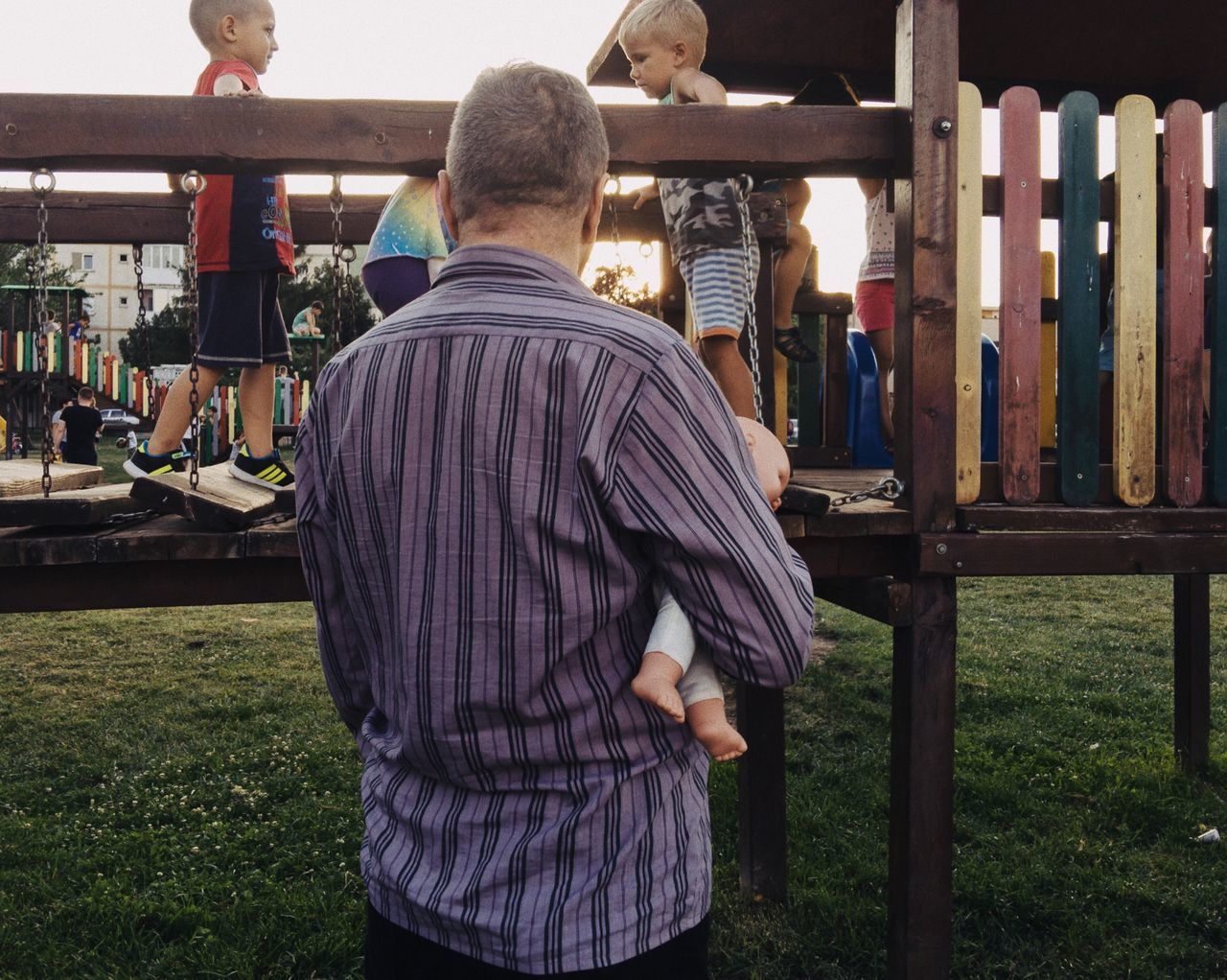 Puppeteer... Rear View Standing People Outdoors Made In Romania VSCO Details Of My Life City Life Lifestyles Street Life City Urban Street Playground Childhood Grandpa Puppet Park Playing Playtime Summer Having Fun Holding Kids Playing Children